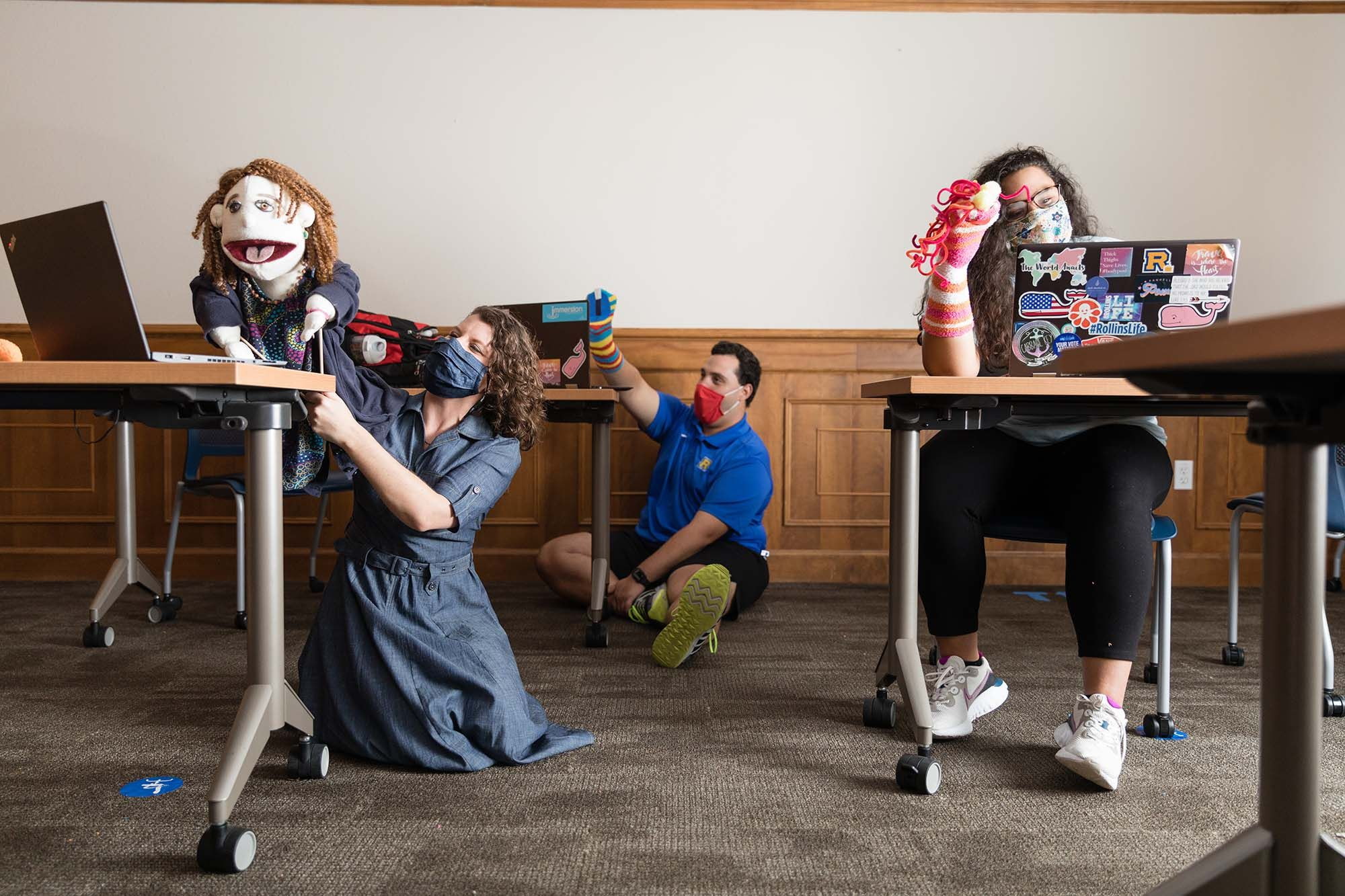 Students attend a virtual puppet workshop