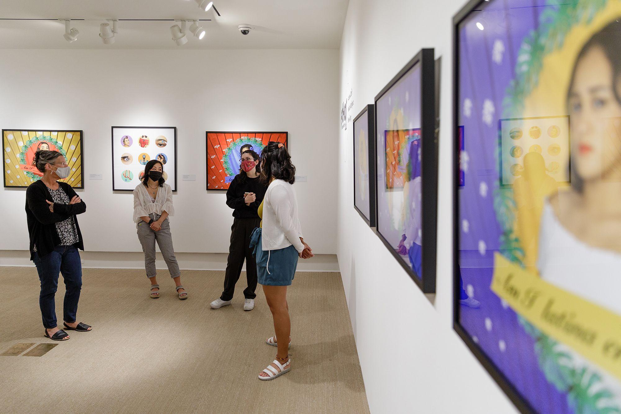 Art professor Dawn Roe and studio art seniors discussing their original art exhibition at the Cornell Fine Arts Museum.