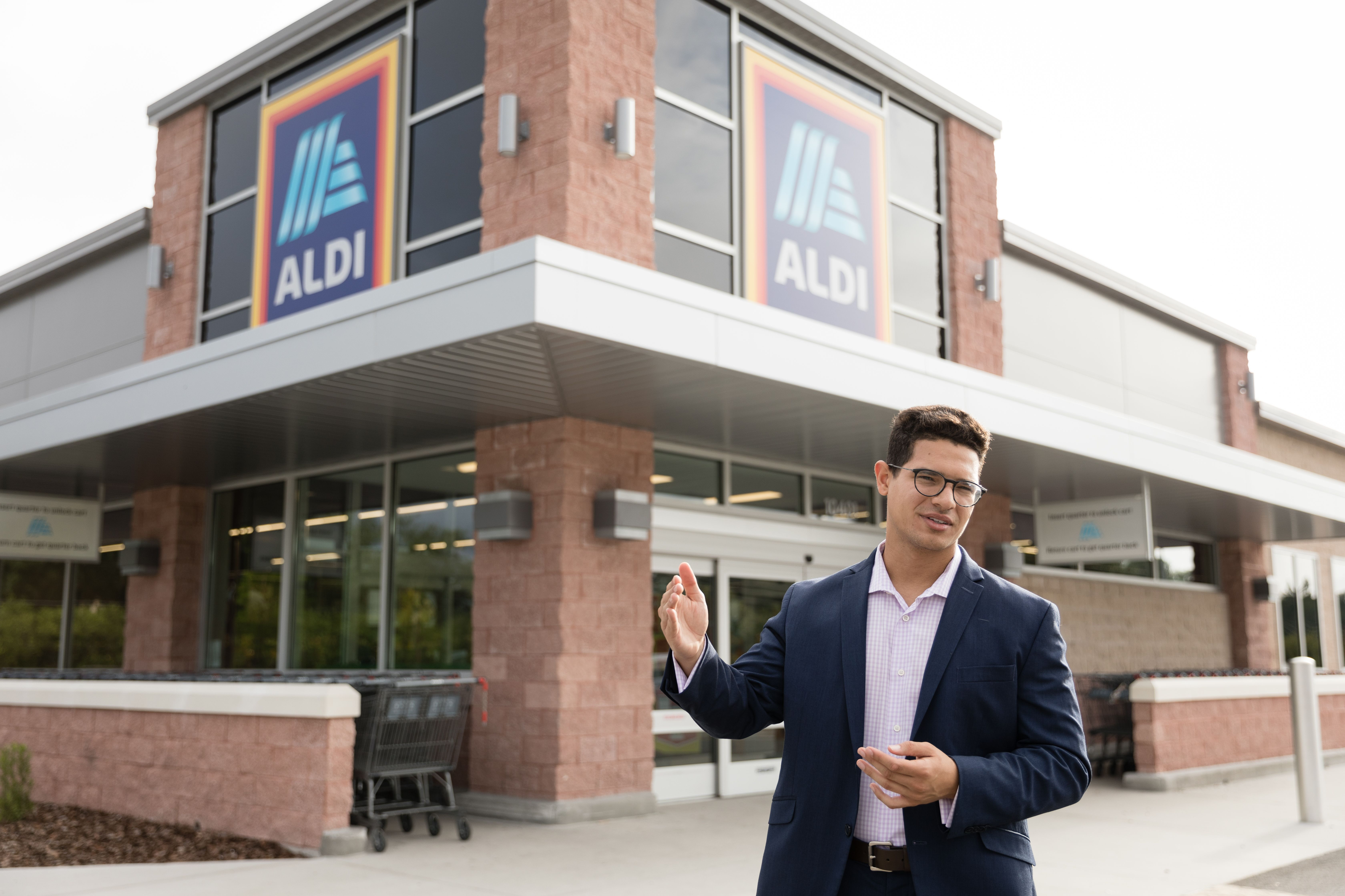 Management intern poses outside an ALDI store in Florida.