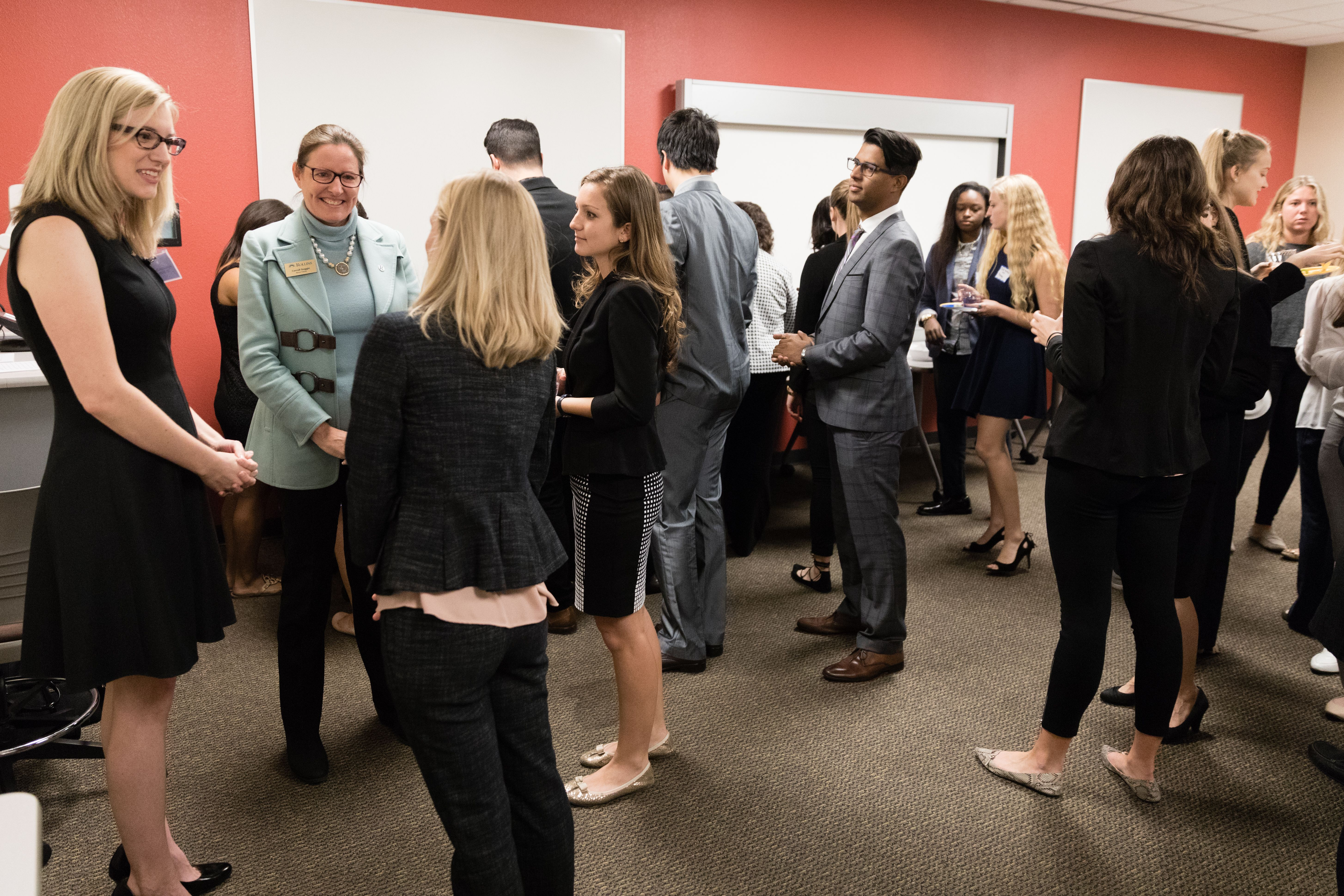 A group of sharp dressed business students networking.