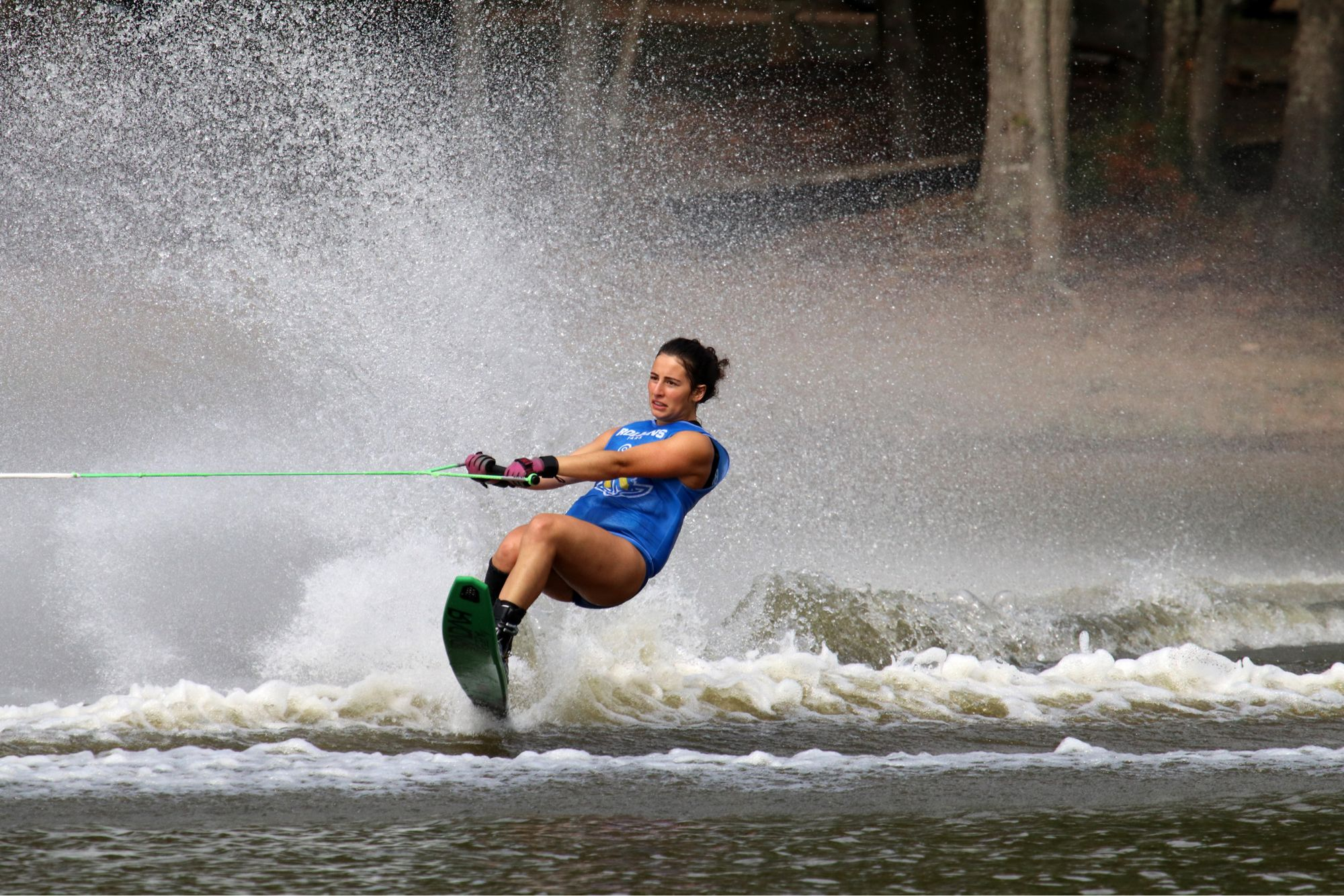 A female athlete skiing during a competition on Lake Virginia.