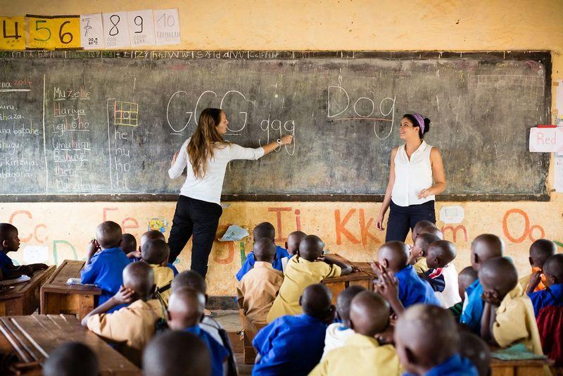 Two student teachers lead a lesson in a elementary school in Rwanda.