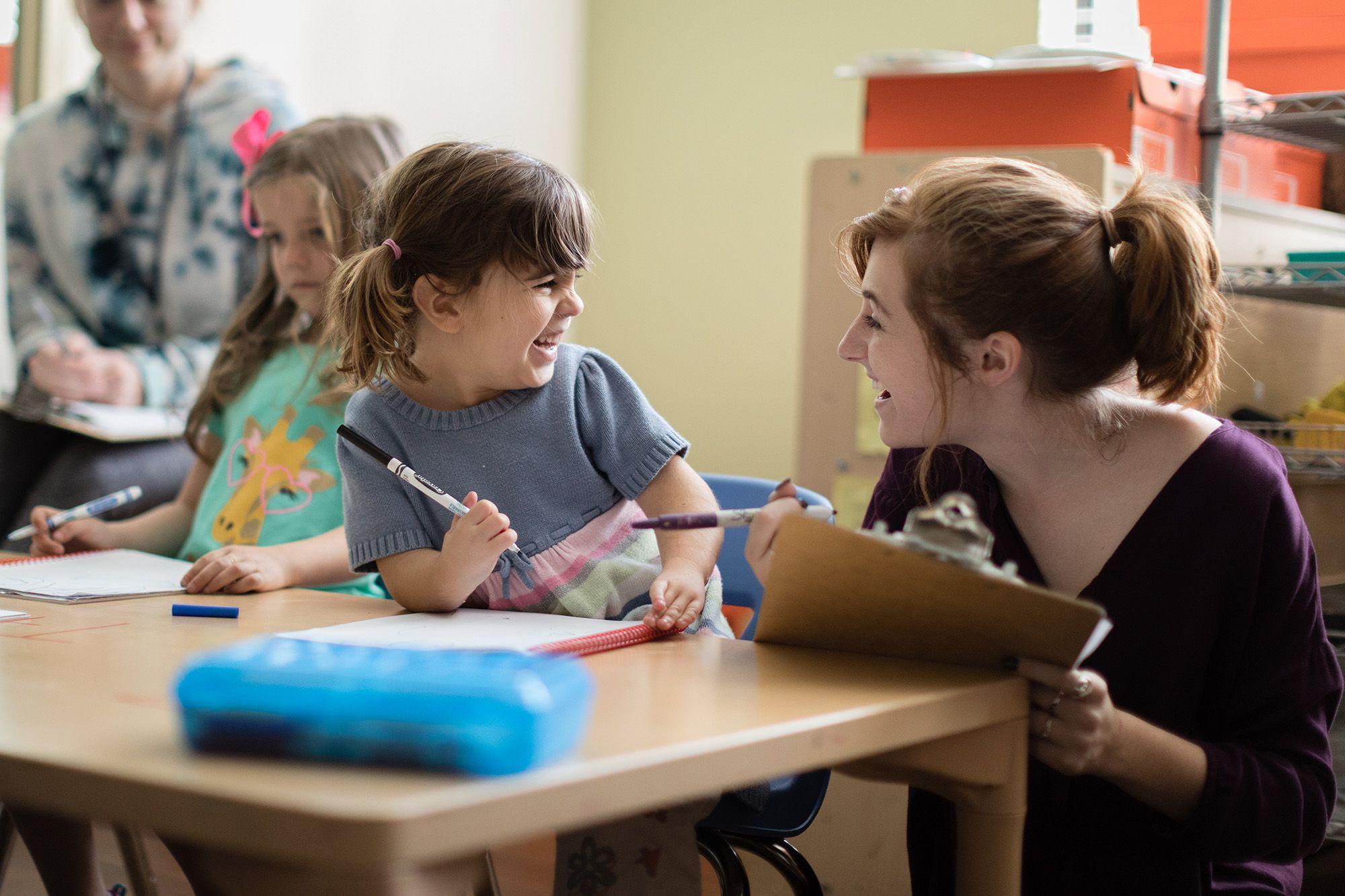 A student researcher interviews a preschool student.