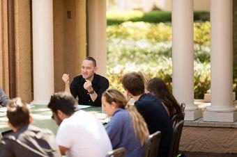 An international relations class meeting outdoors.