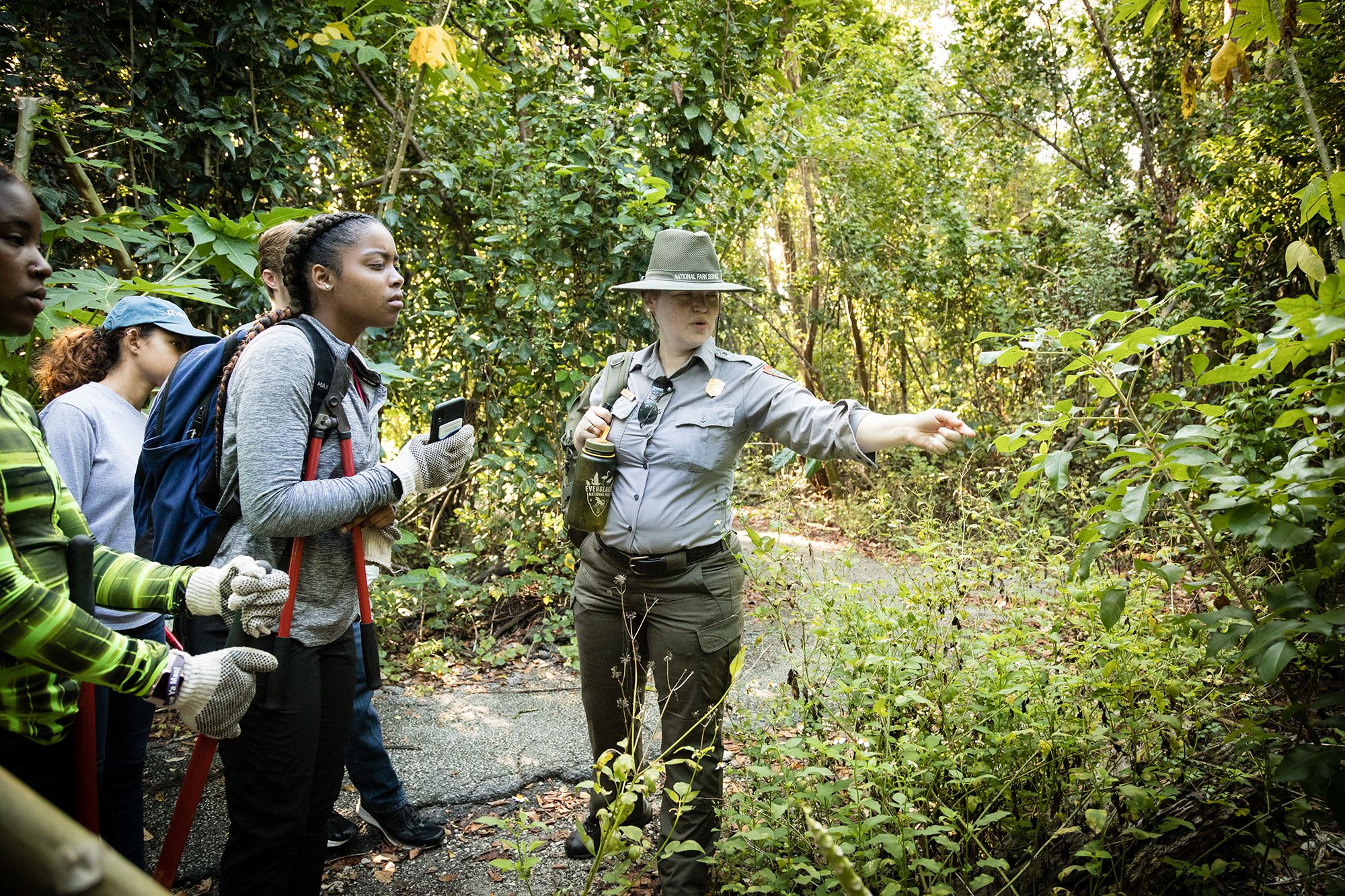 A park ranger educates students about the flora and fauna in the Everglades.