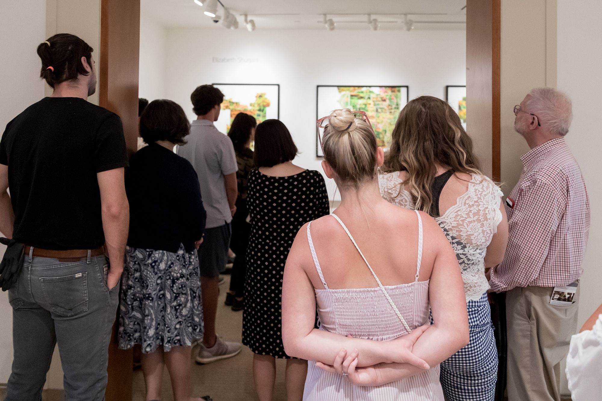 Onlookers at the senior art show in Rollins' Cornell Fine Arts Museum.