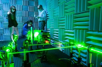 Physics perform acoustical research with lasers in Rollins' anechoic chamber.