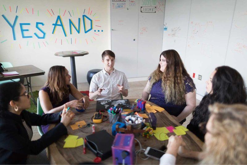 Rollins students brainstorming together.