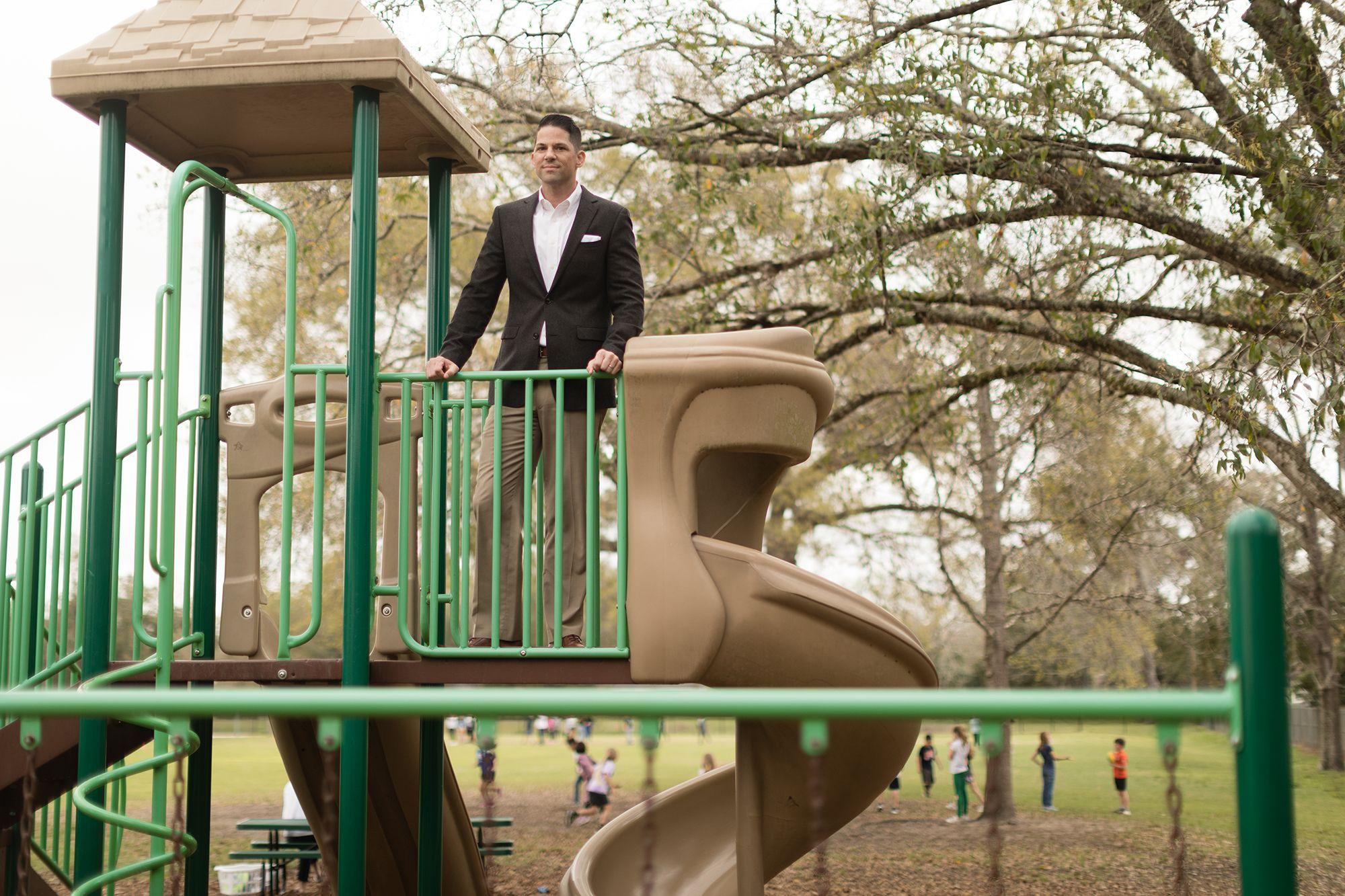 Neil Otto '05 pictured on playground near campus.