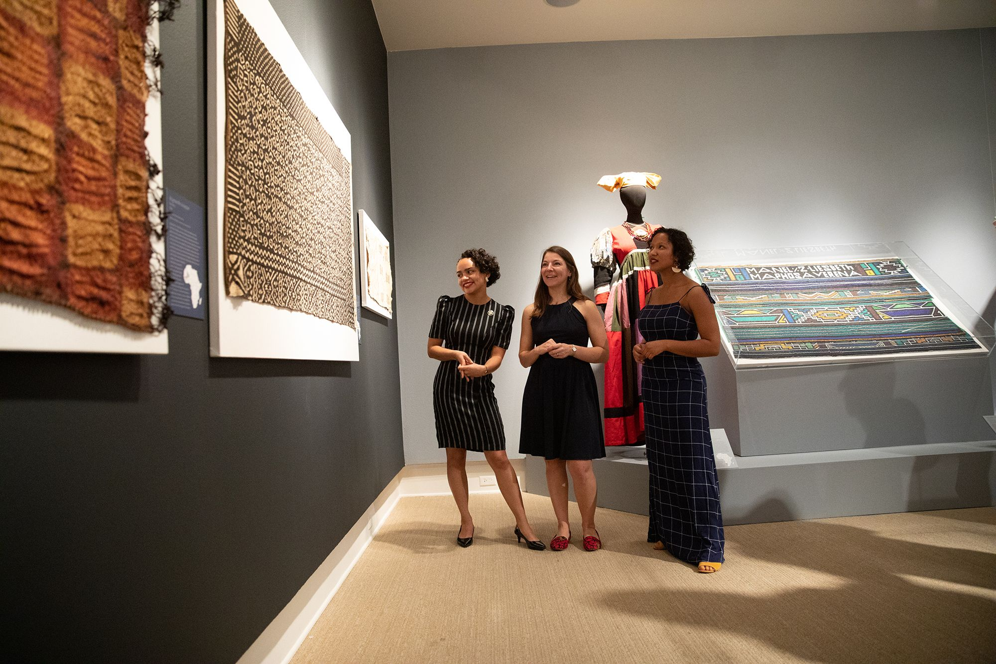 A professor and two students explore the exhibition they curated at the Cornell Fine Arts Musuem.