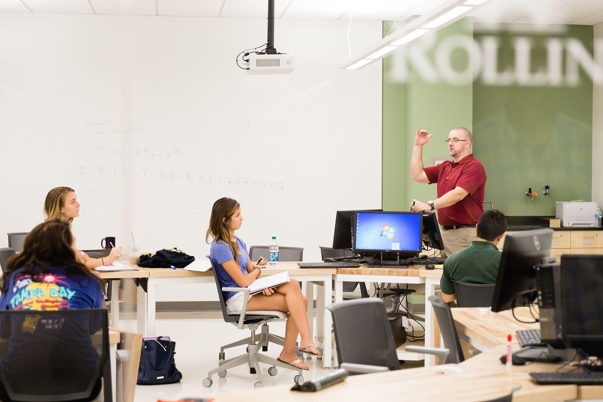 Physics professor Chris Fuse explains concepts in class.