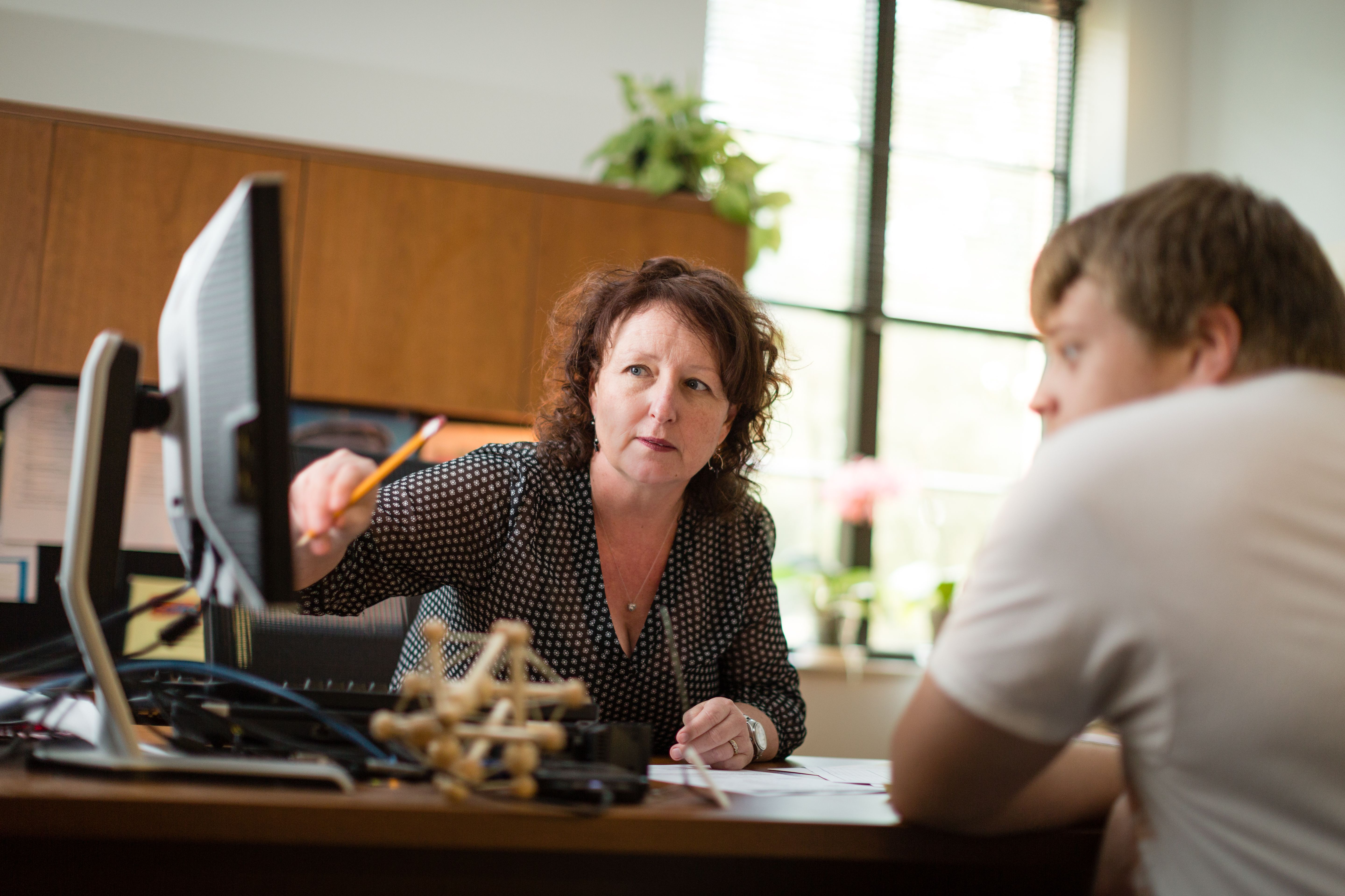 Biology professor Fiona Harper holds a one-on-one advising session in her office with a student.