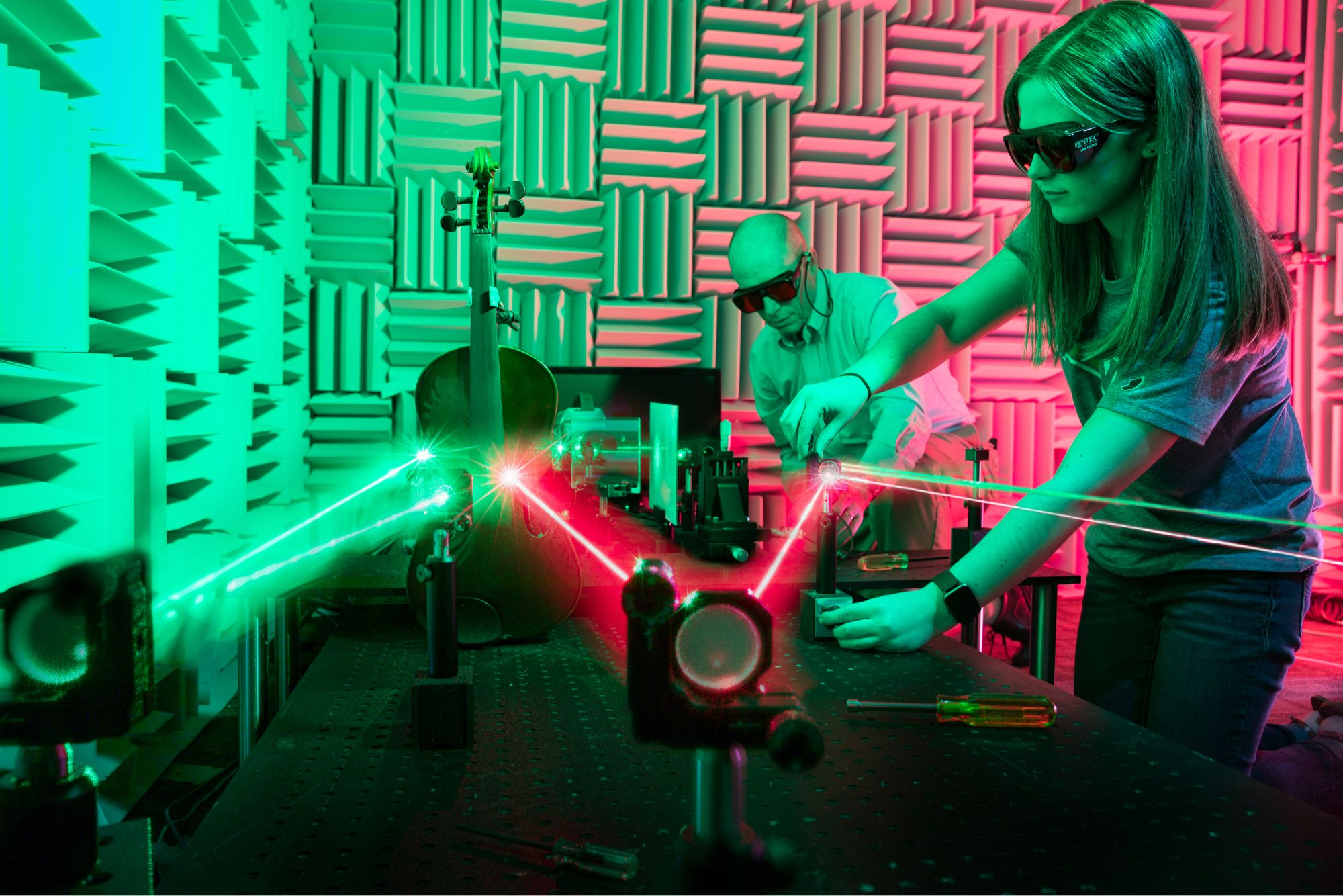 Student and professor performing laser research in Rollins' acoustics lab.