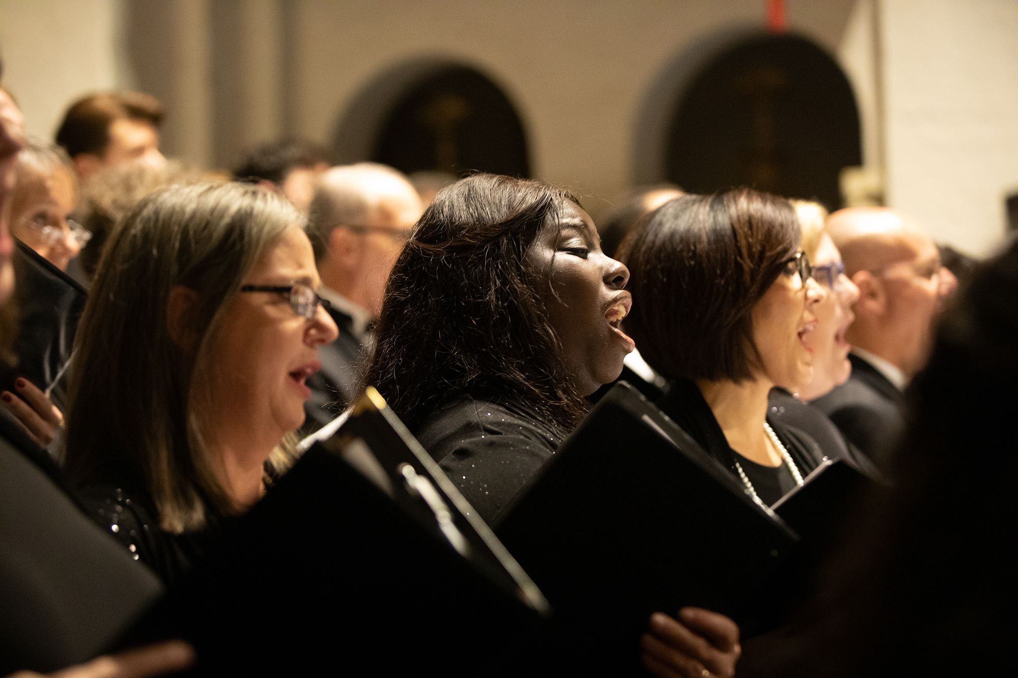 A choir singing during a performance at Knowles Chapel.