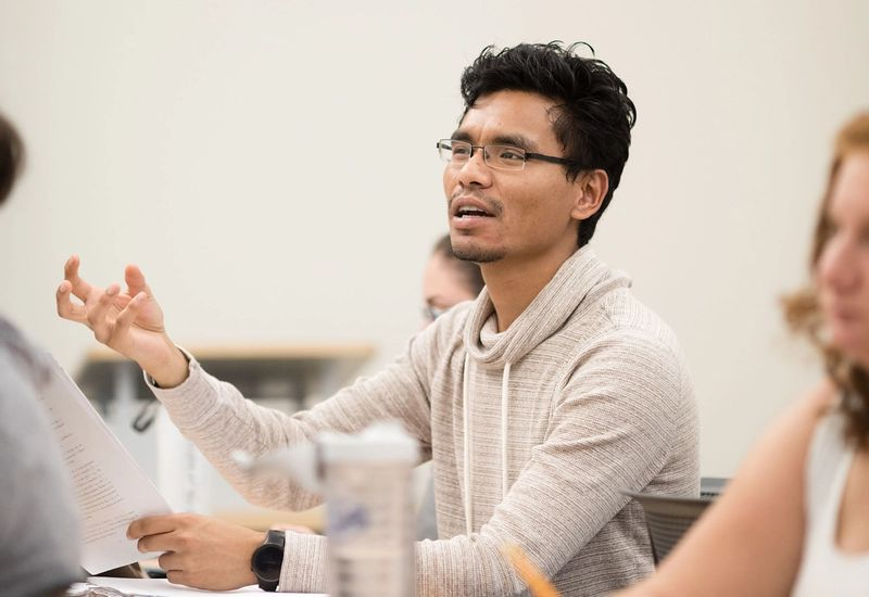 A student answers a question in a Rollins math class.