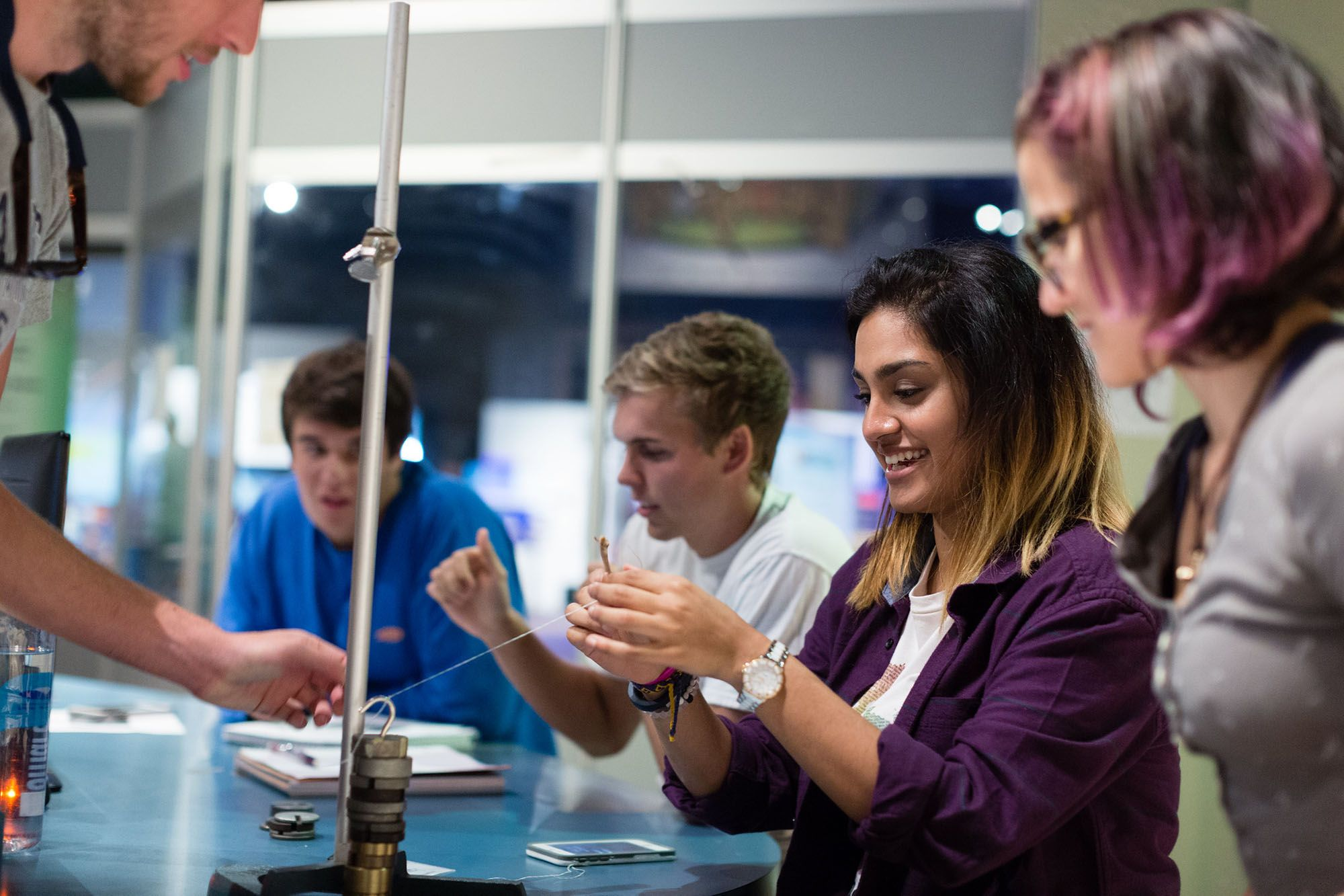 Students experiment with weights and measures as part of a physics course.