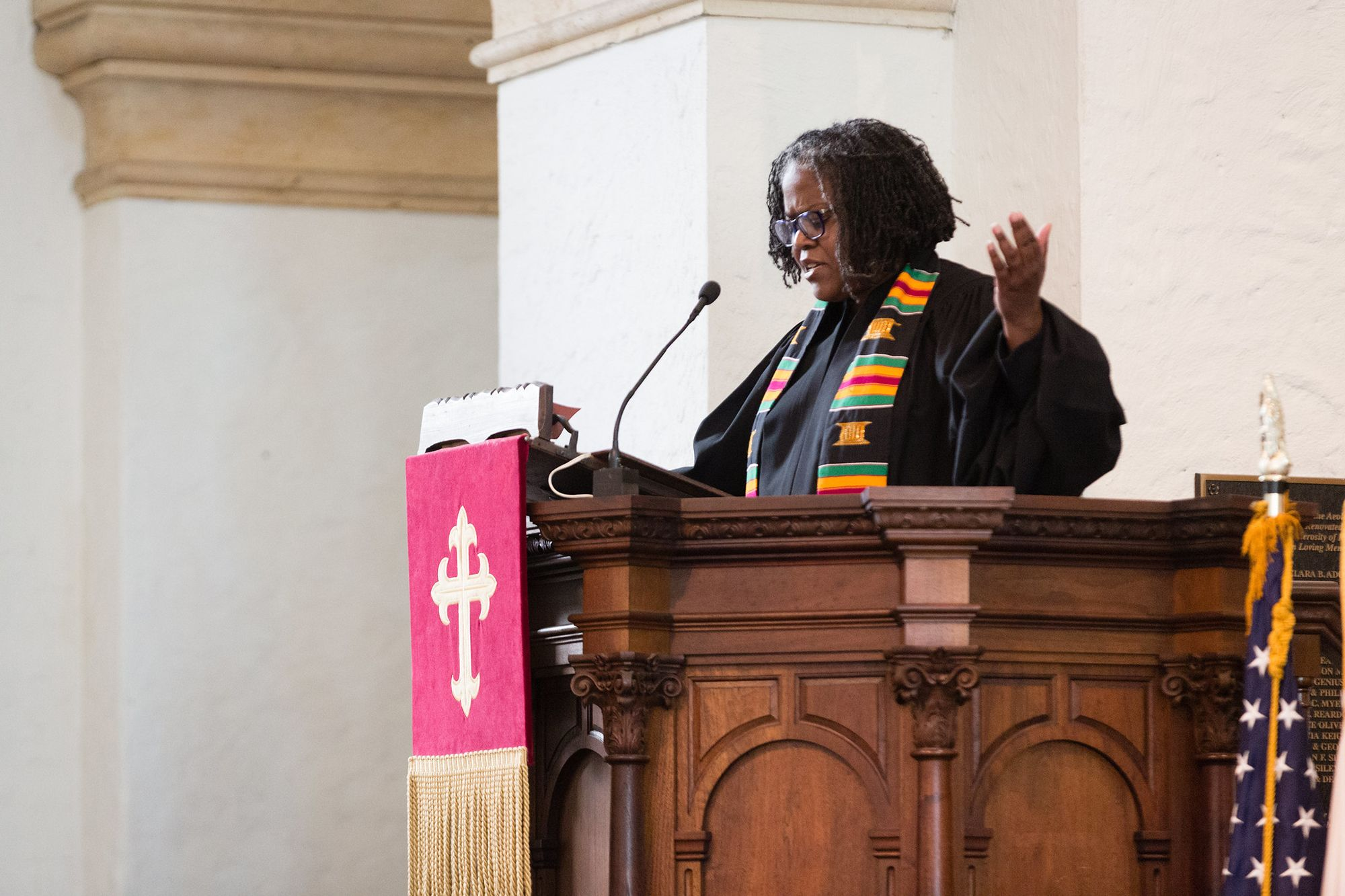 Rev. Katrina Jenkins, Rollins' dean of religious life, speaks from the pulpit in Knowles Memorial Chapel.