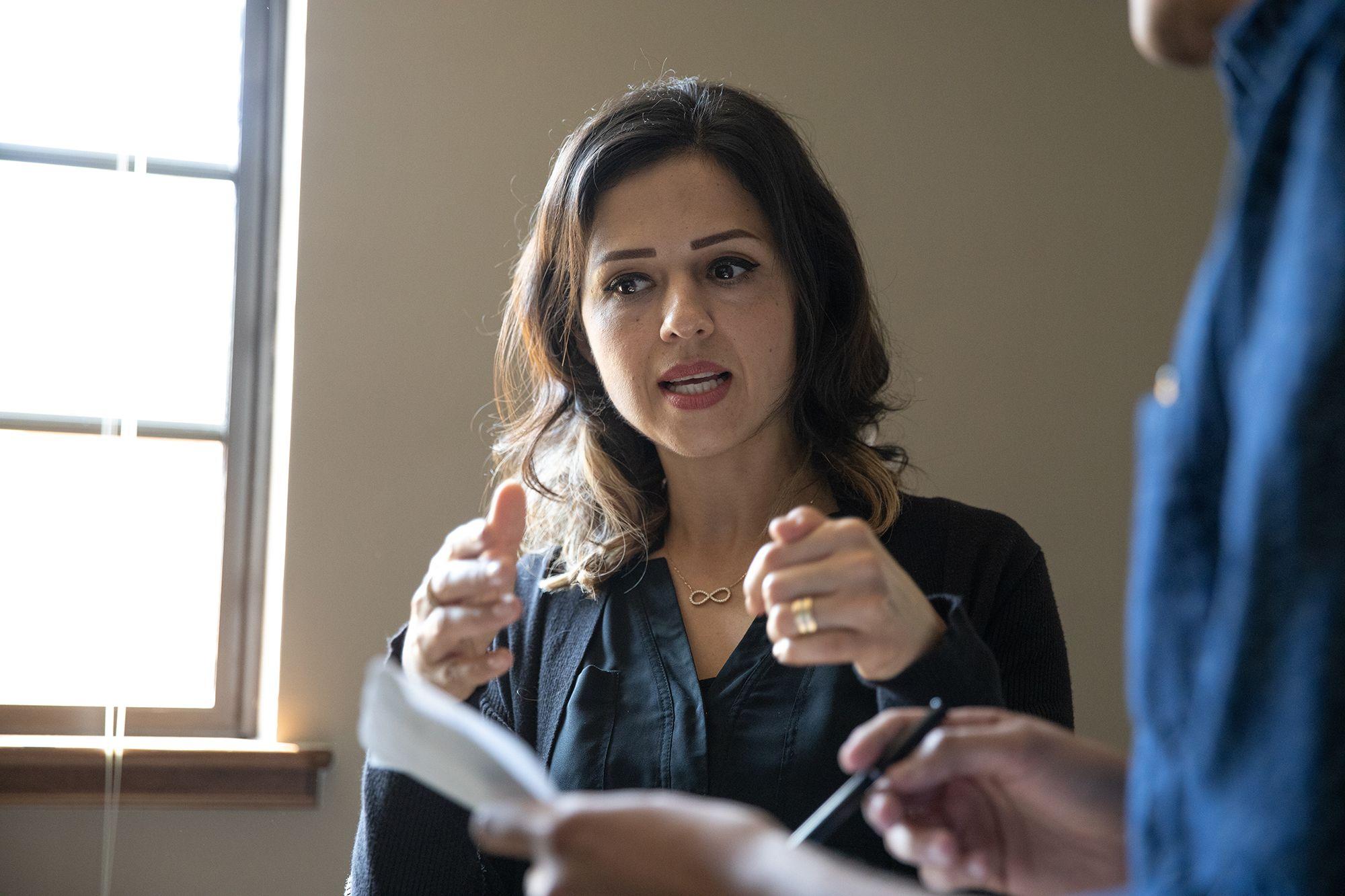 An international business college professor seaking to her class.
