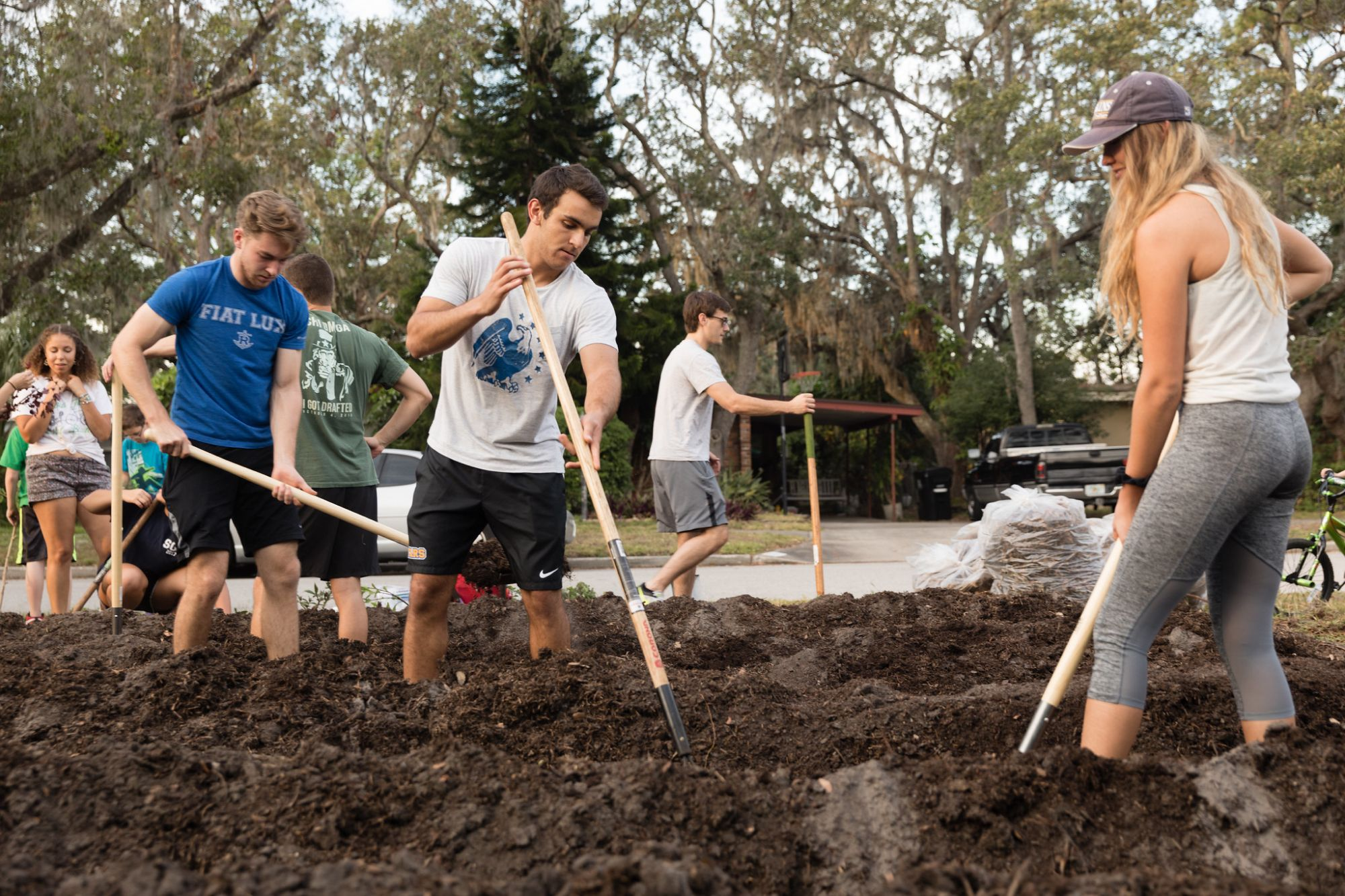 Students hard at work digging trenches.