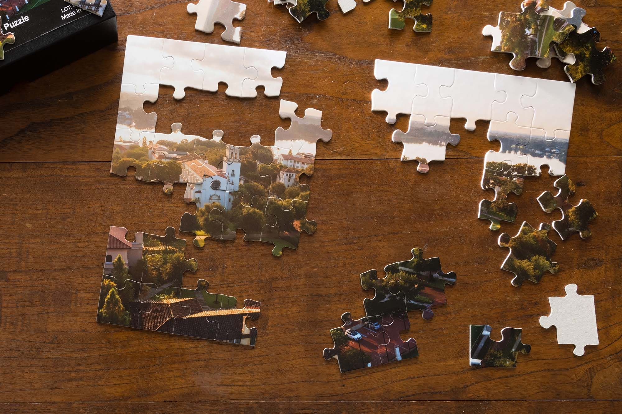 A half-completed puzzle featuring the Rollins campus