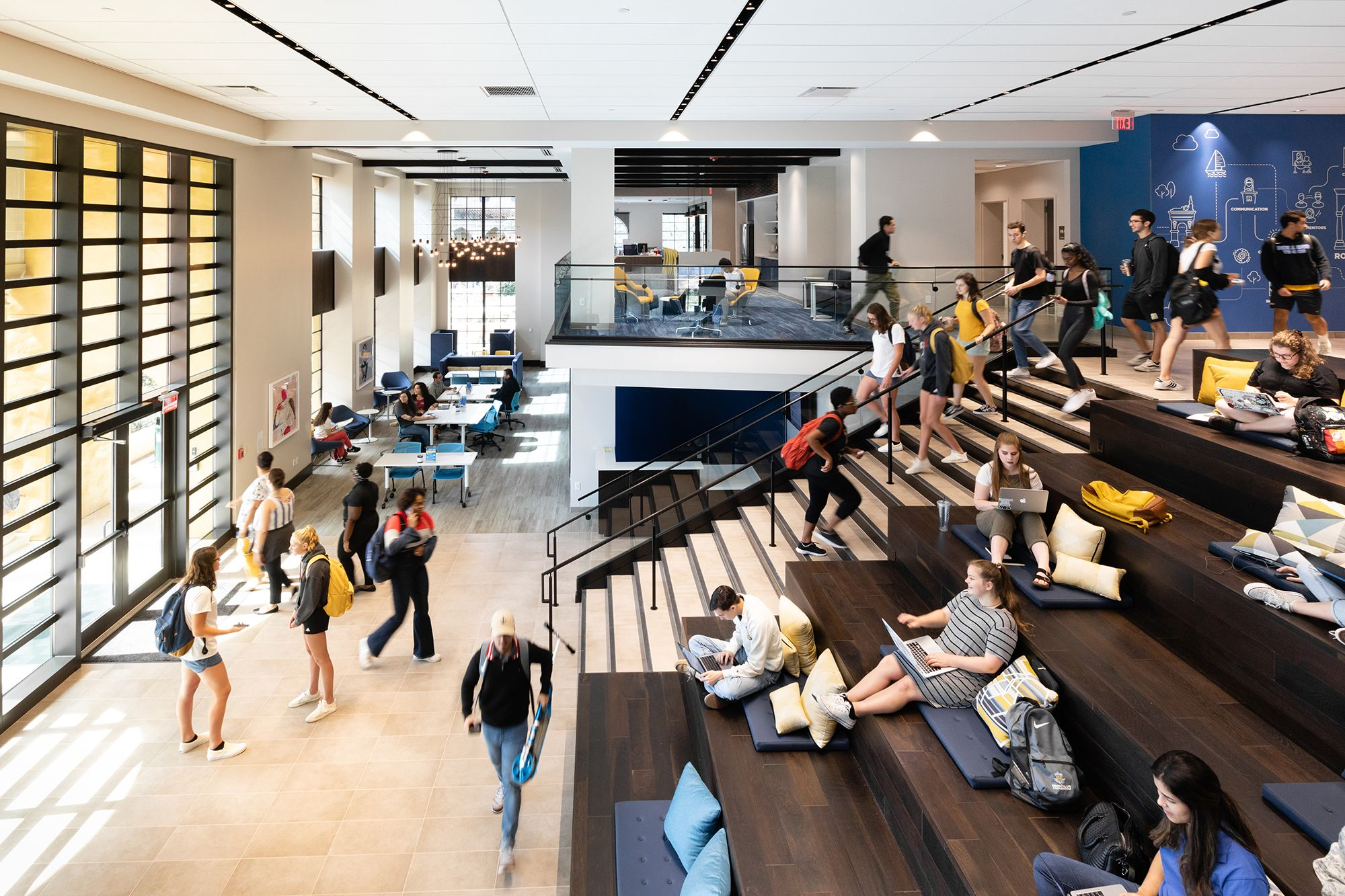 Students sitting and traveling through the plateaued atrium of KWR Hall.