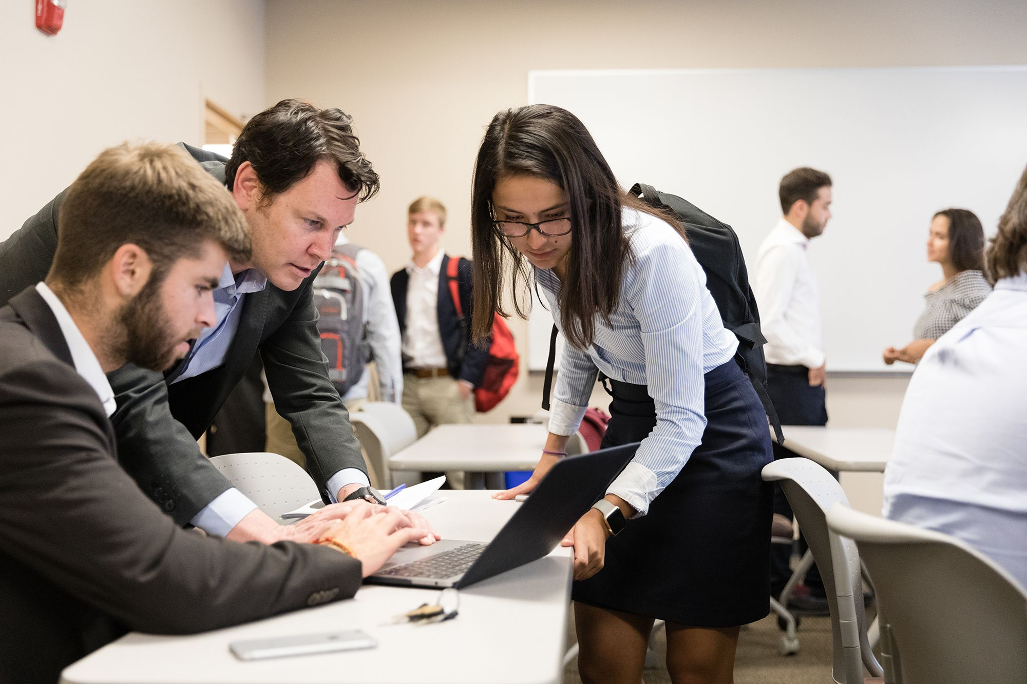Students work on a project in an international business marketing class.