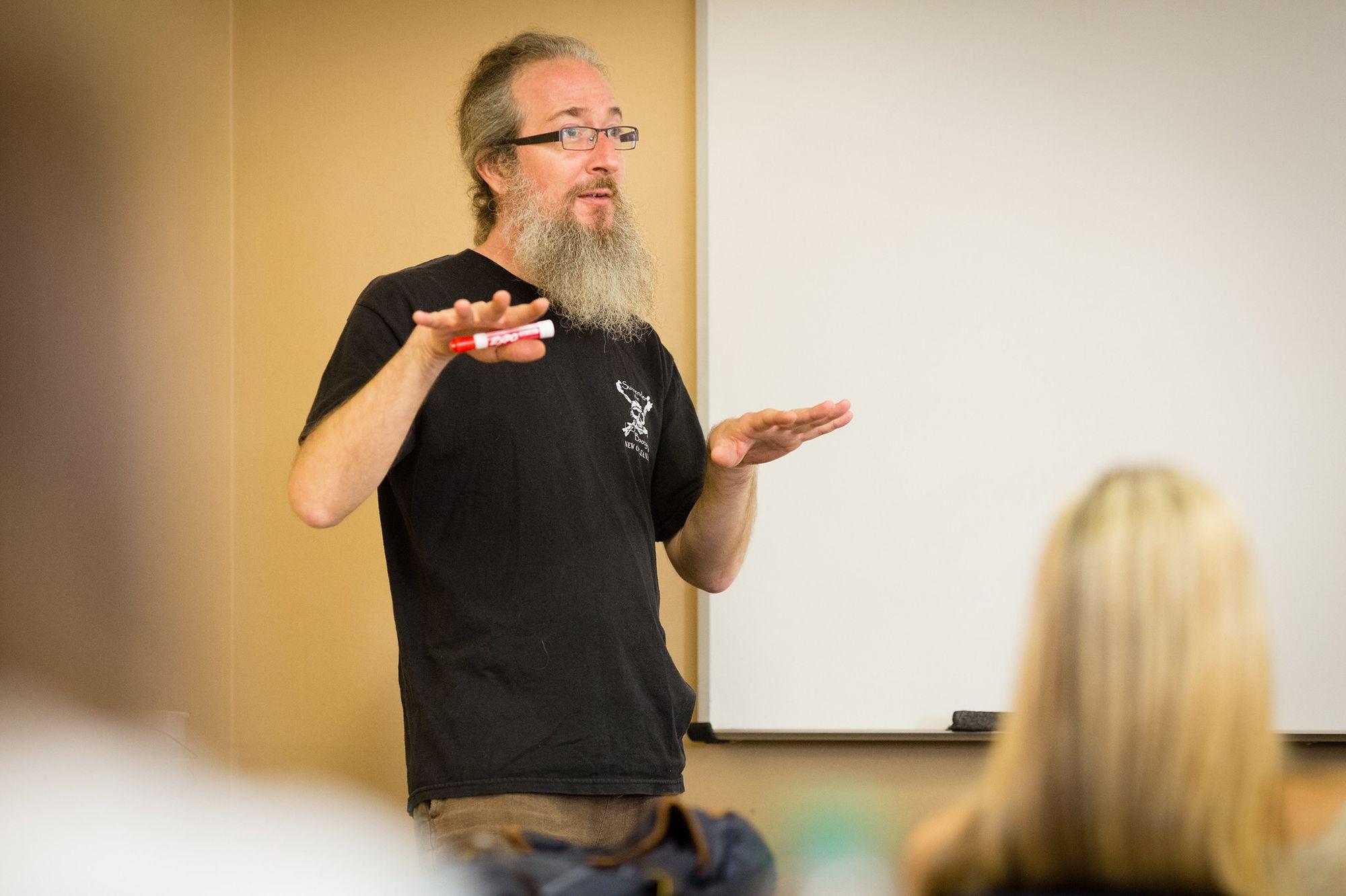 Professor, Phil Kozel, standing and addressing his class.