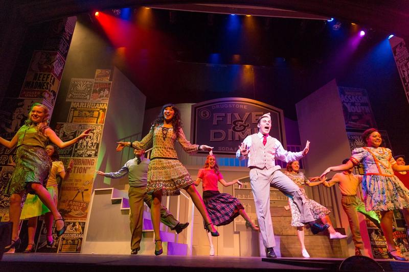 Students dance in a musical on the Annie Russell Theatre stage.