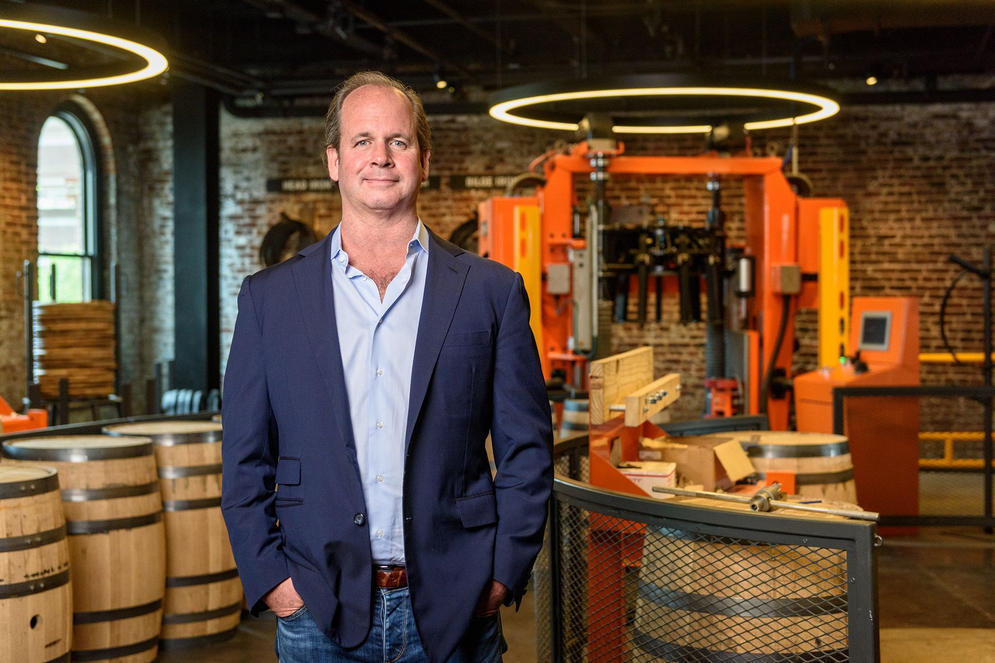 Campbell Brown poses in front of the barrel cooperage at the Old Forester Distillery.