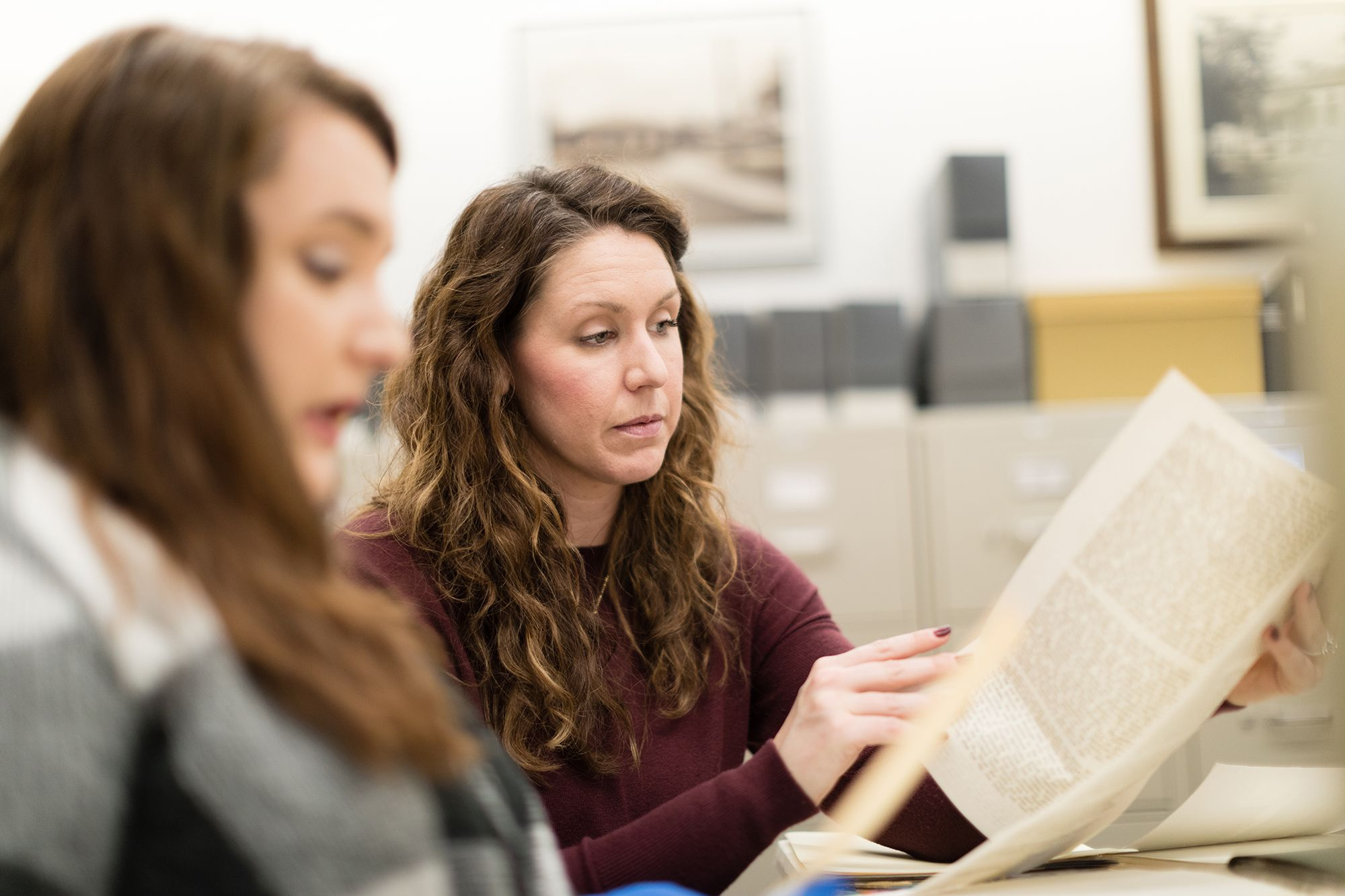 Rachel Walton reading archived papers in a class research project.