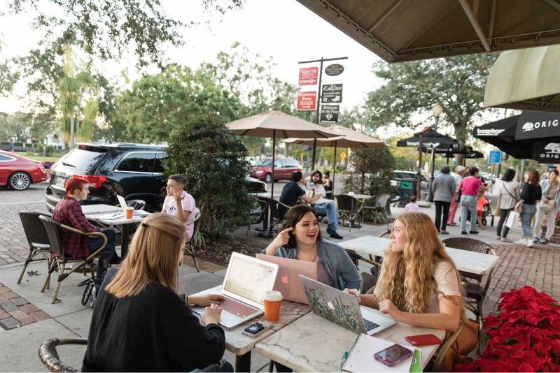 Rollins students work on their laptops at a café on Park Avenue.
