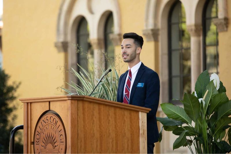 A student speaks at a podium.