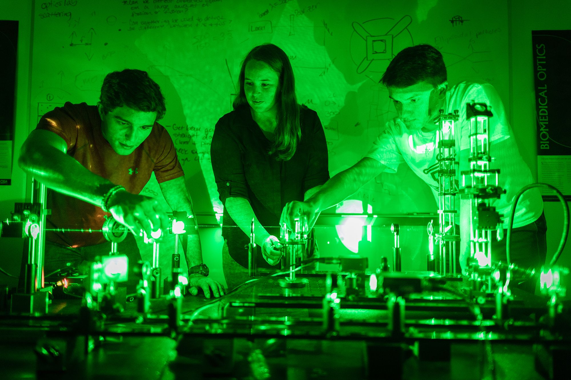 Students researching lasers for a physics lab.