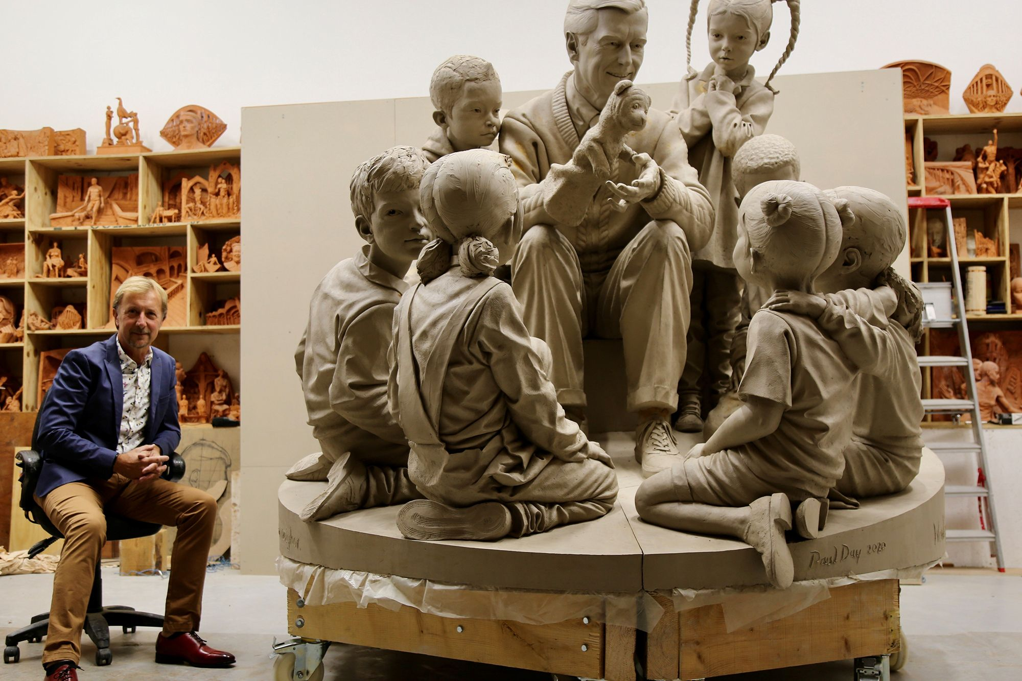 Artist Paul Day pictured next to the sculpture he's creating of Mister Rogers for Rollins College.