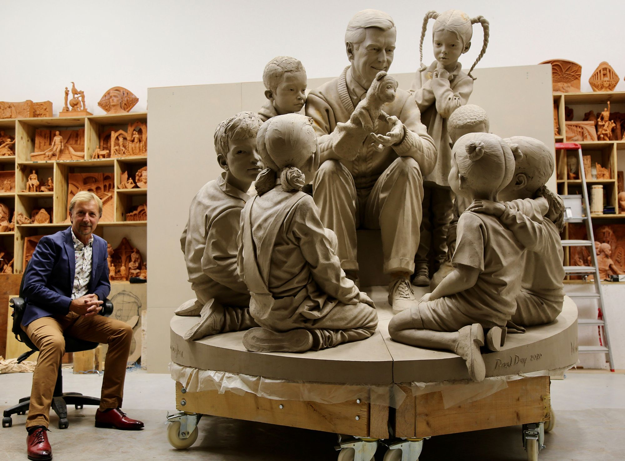 Artist Paul Day pictured with the unfinished sculpture of Mister Rogers for Rollins College.