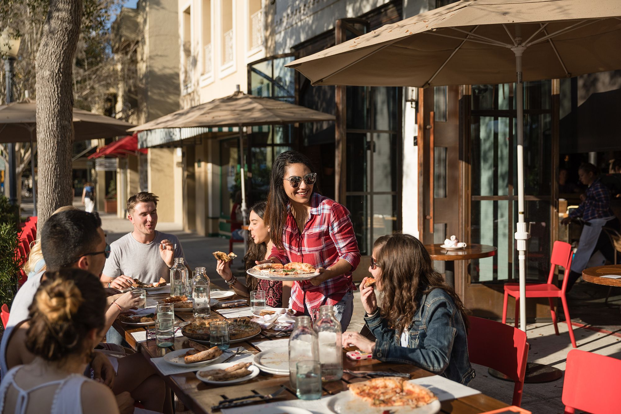 Students share pizza at Prato on Park Avenue.