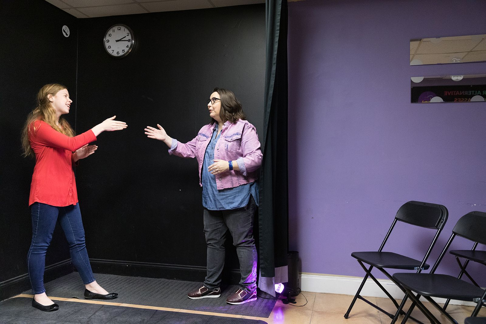 AnnMarie Morrison '20 and Lauren Morris '99, a Rollins student and a Rollins grad, perform improv exercises in a Winter Park, Florida, theatre.