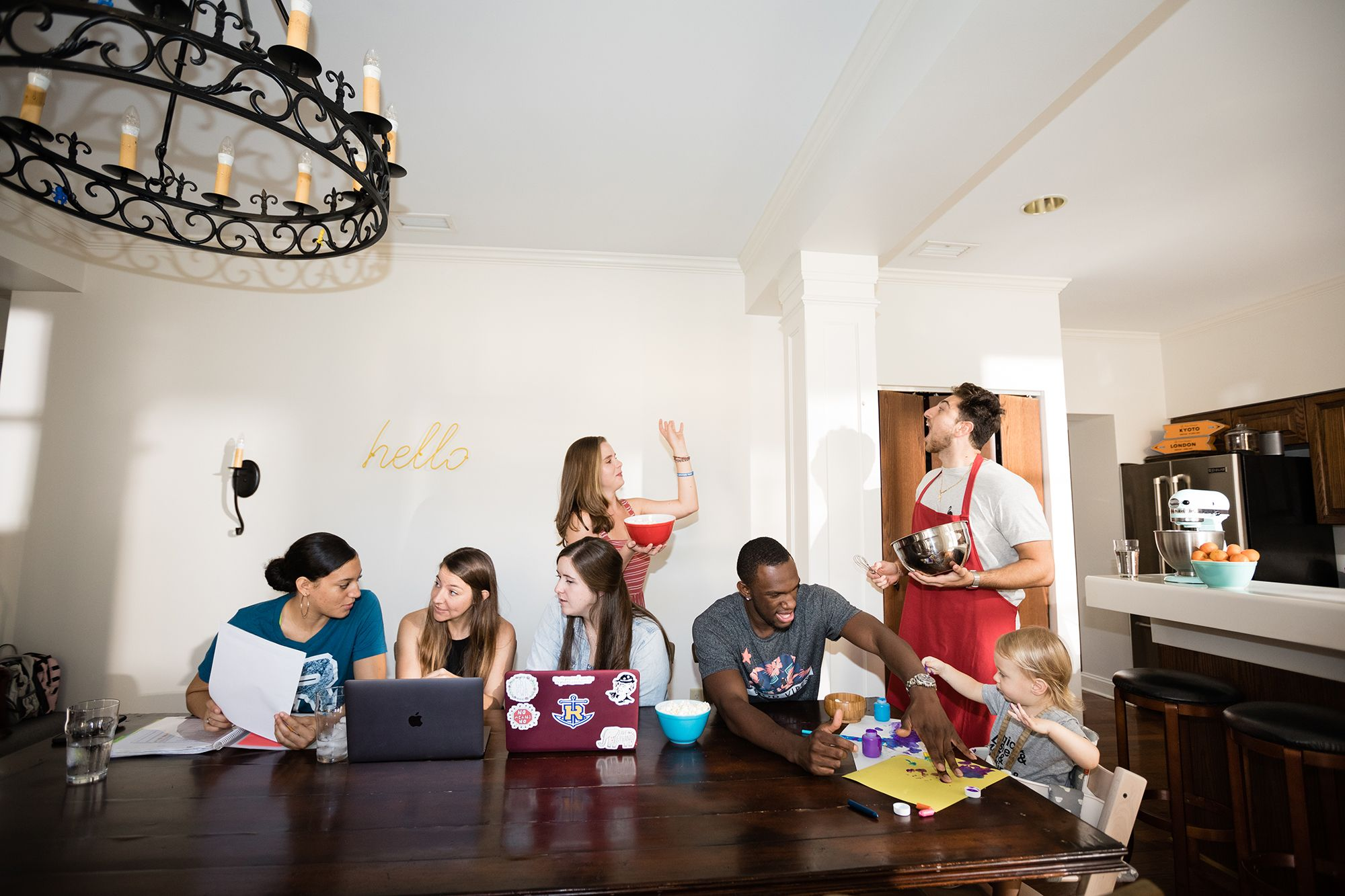 Students and professor share space in one of Rollins' Living Learning Communities.