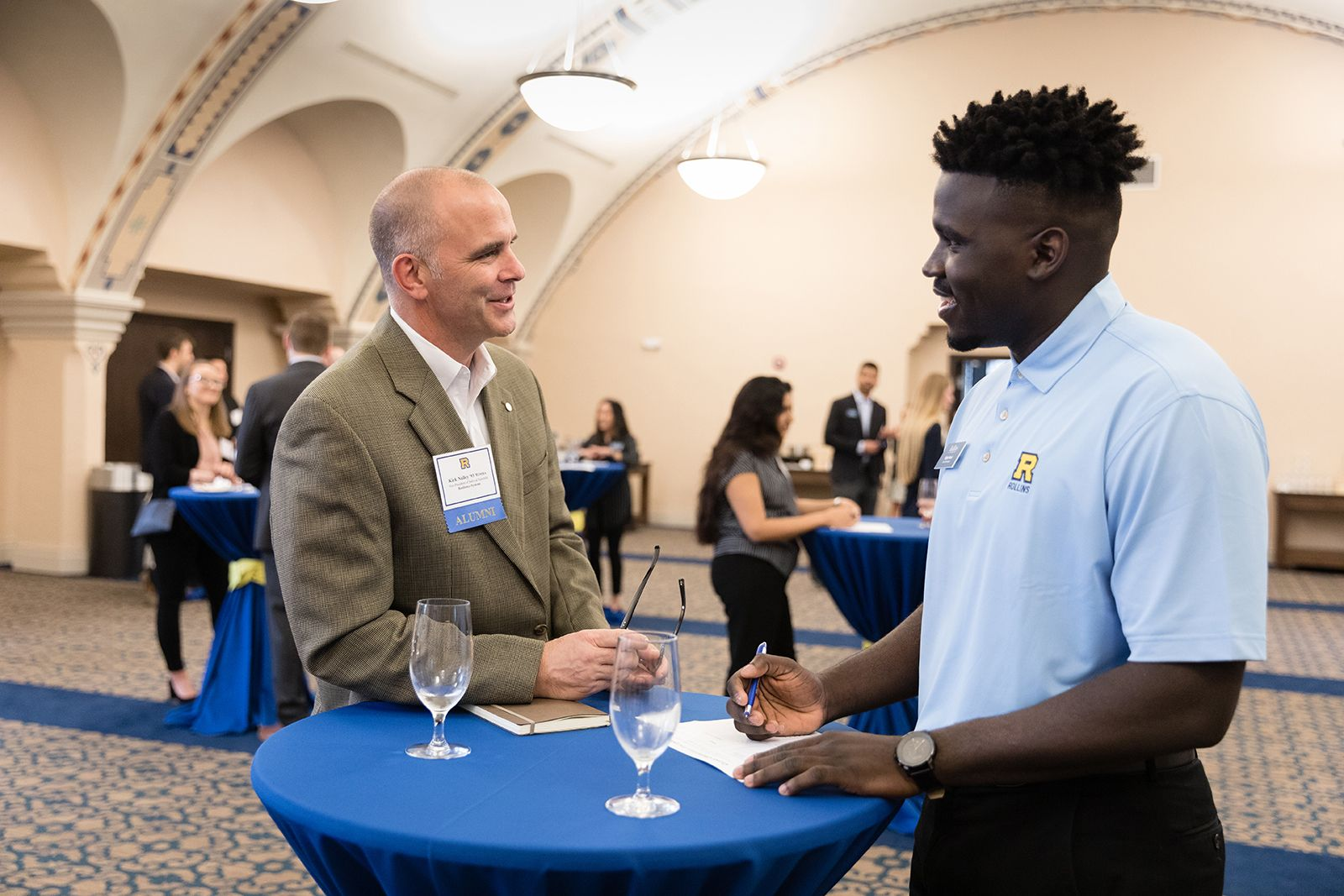 Kirk Nalley '93 '01MBA and Elijah Noel '20, a Rollins graduate and Rollins student, discuss international business careers.
