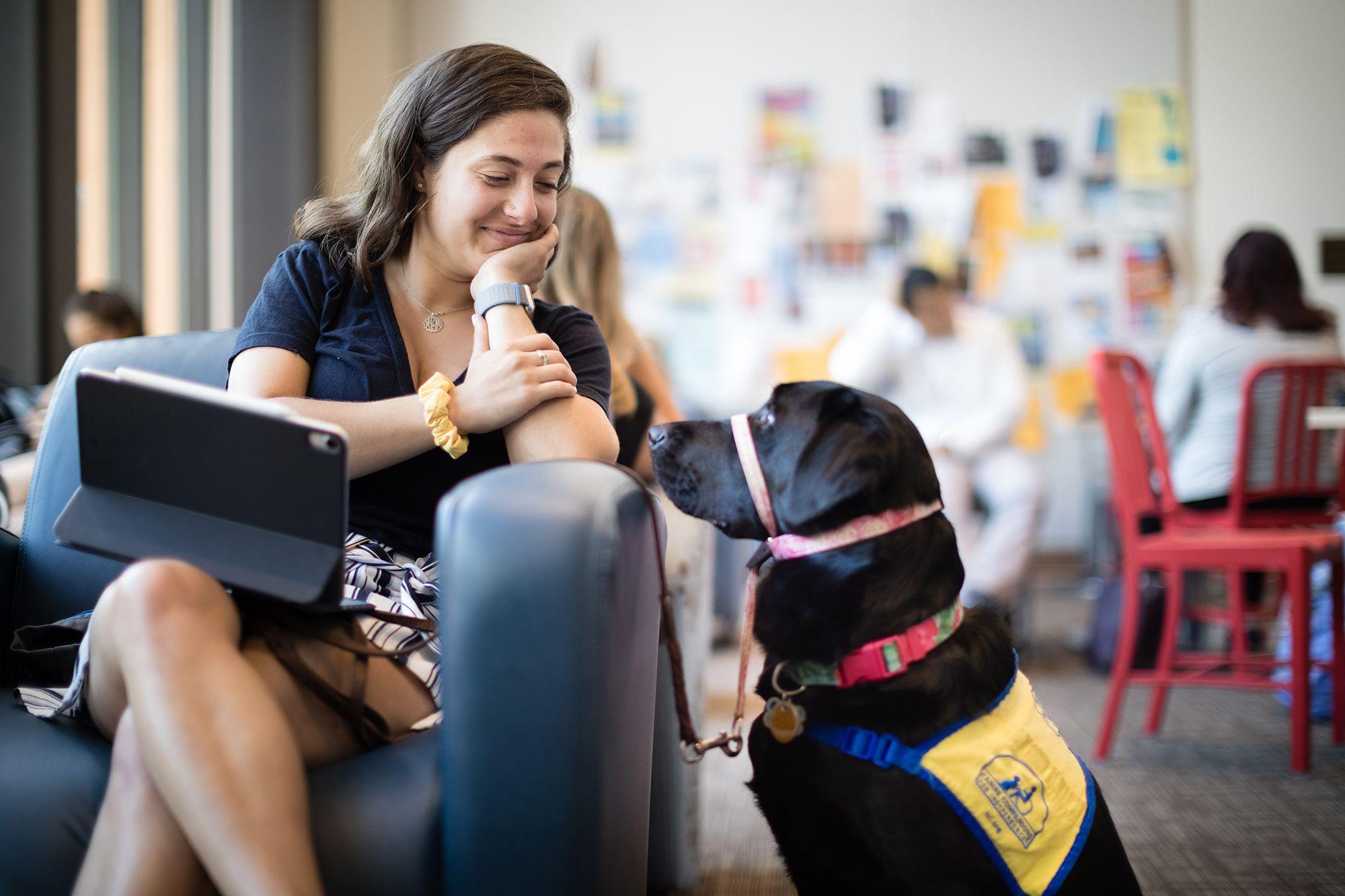 Marissa Cobuzio on a study break with Ari, the service dog she's raising on campus.