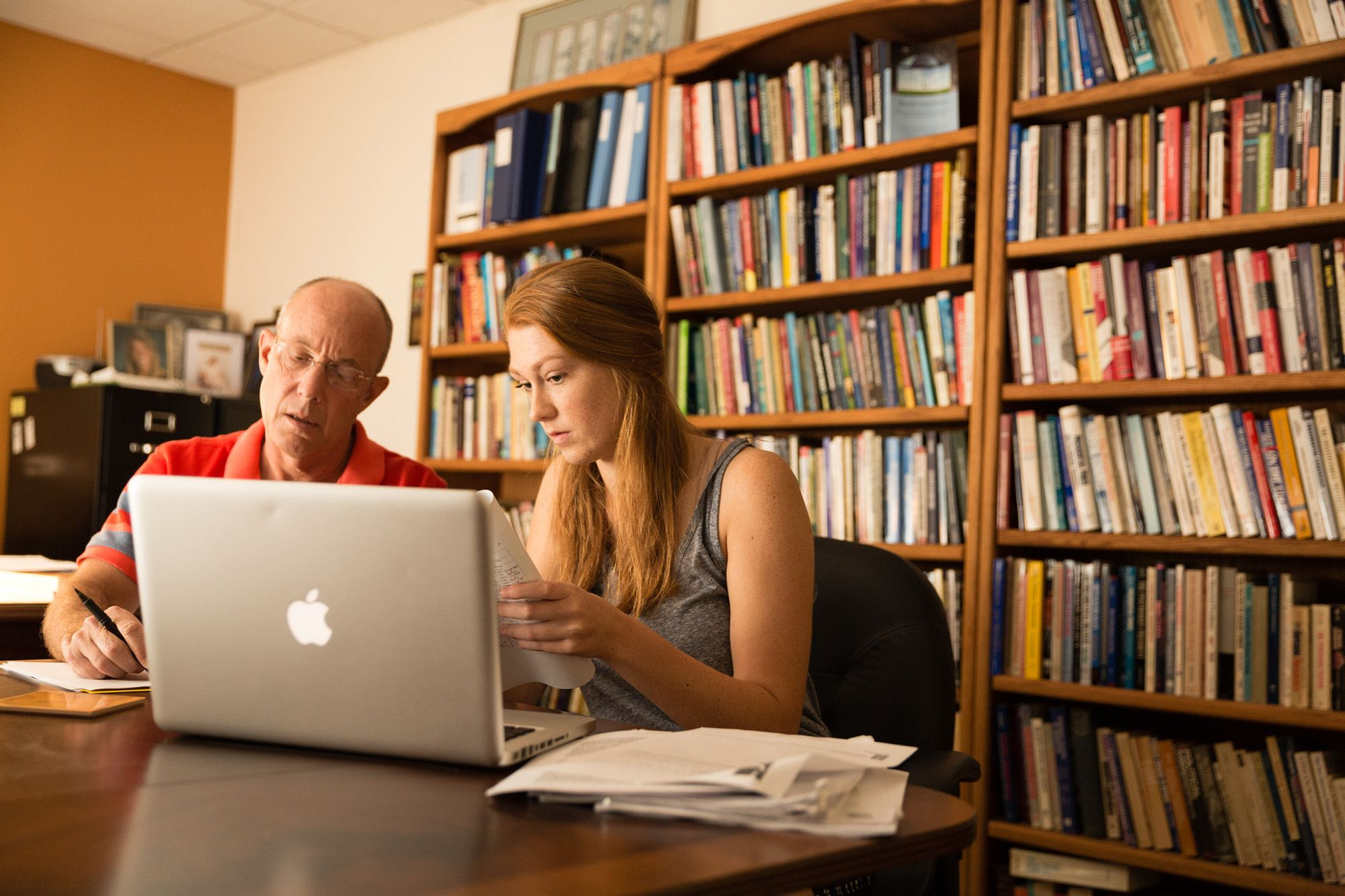 Political science professor Don Davison works with student on original research.