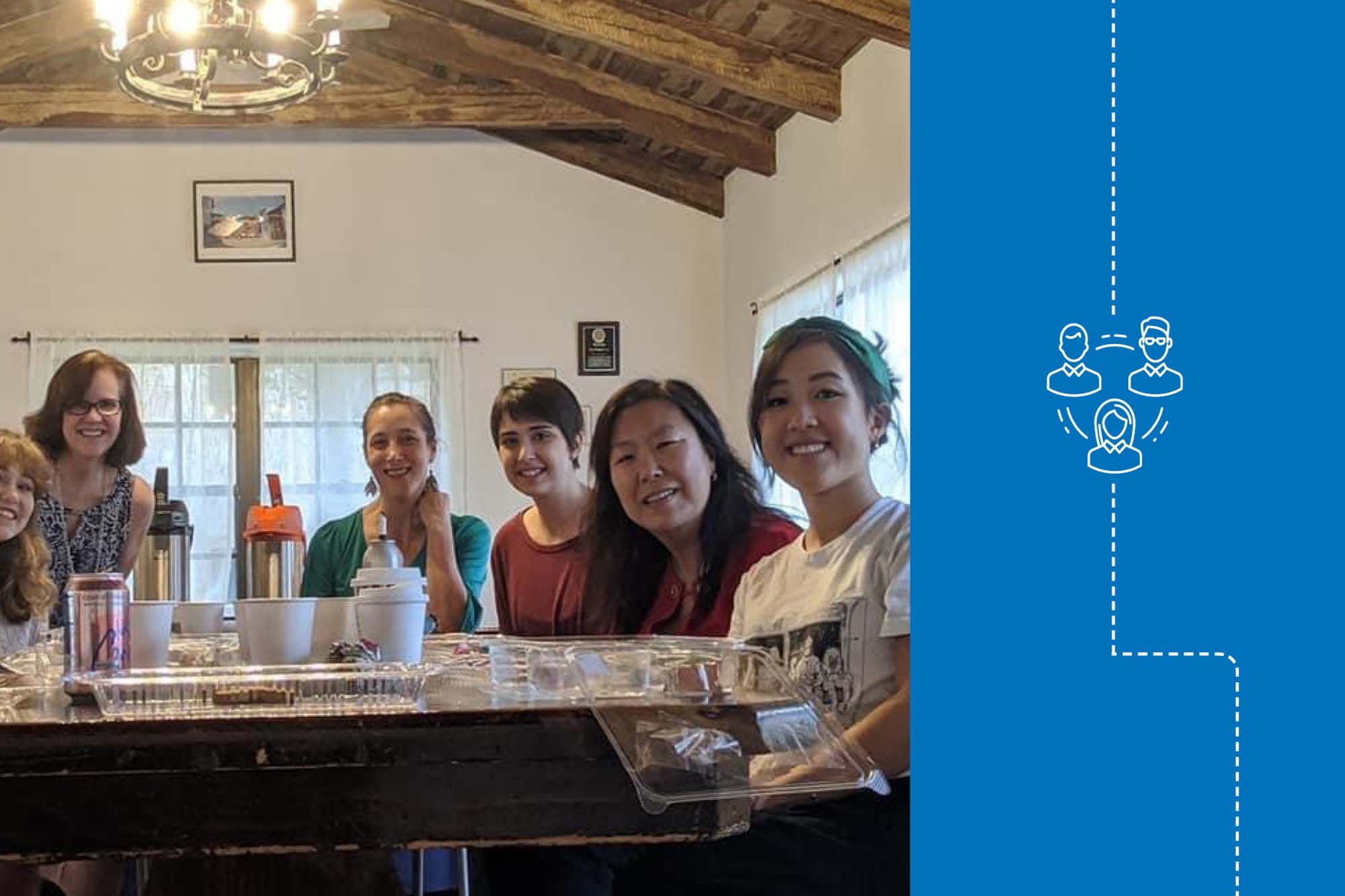 Renee Sang '21 gathers with co-workers in Rollins' Office of International Programs.