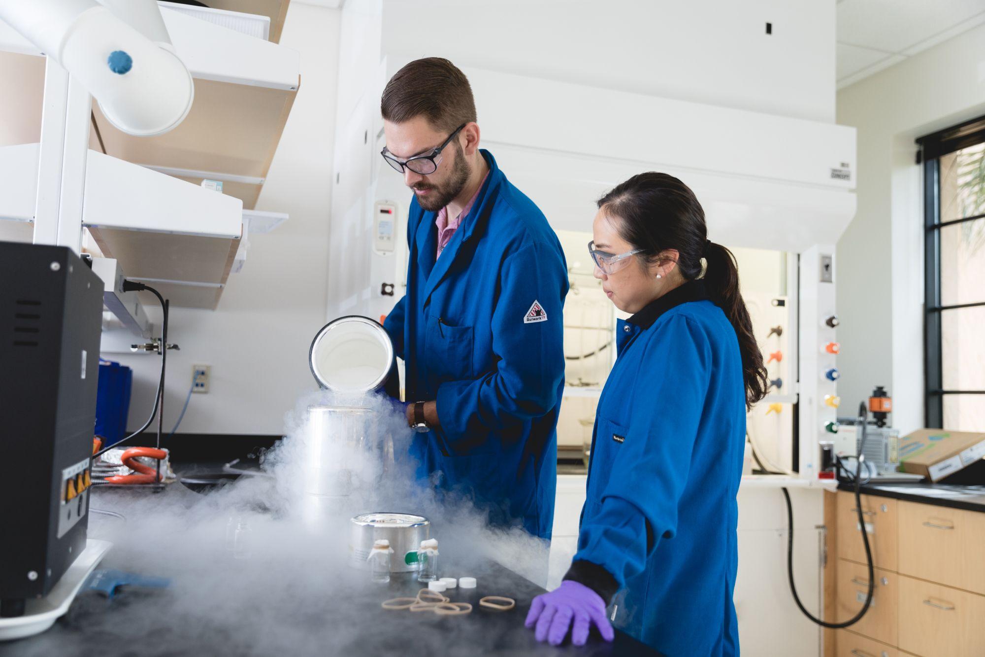 Ellane Park and Julian Grundler working with liquid nitrogen.