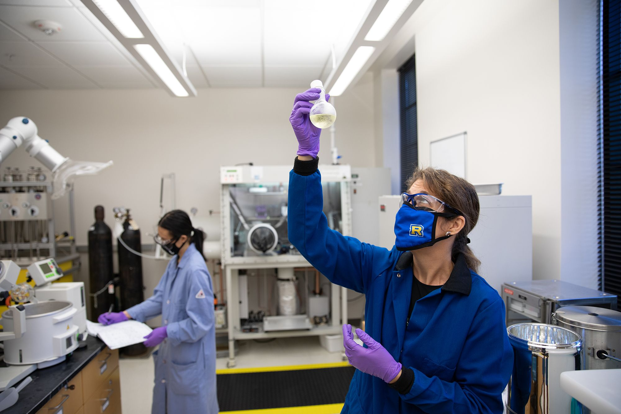 A professor and student conduct chemistry research.
