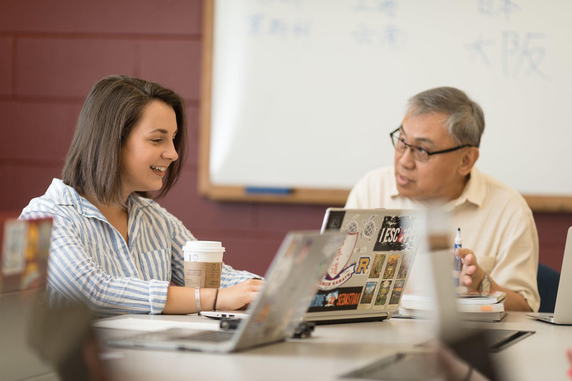 Karina Barbesino talking with her professor