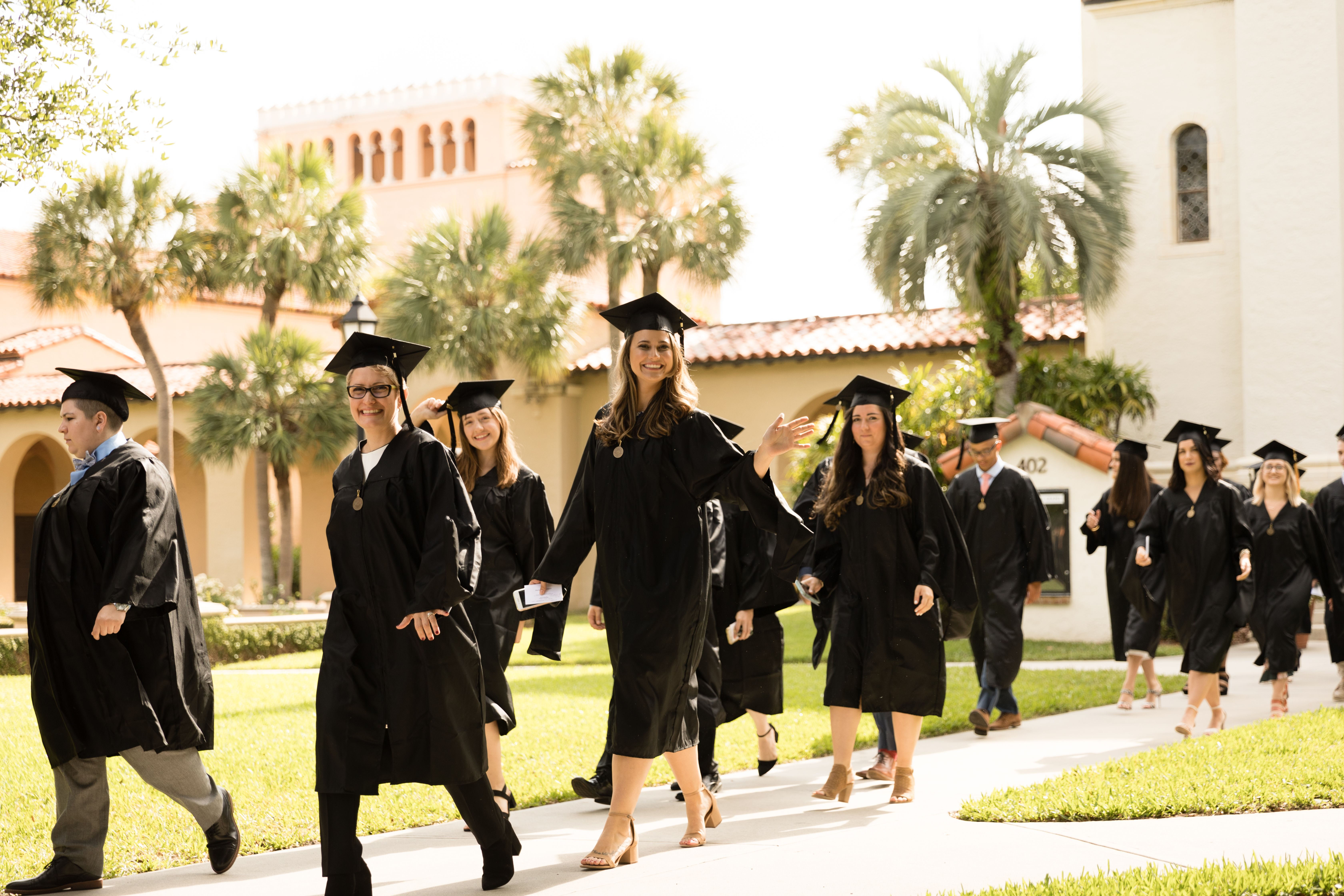 Students walking from the Knowles Chapel to the Alfond Sports Center on graduation day.