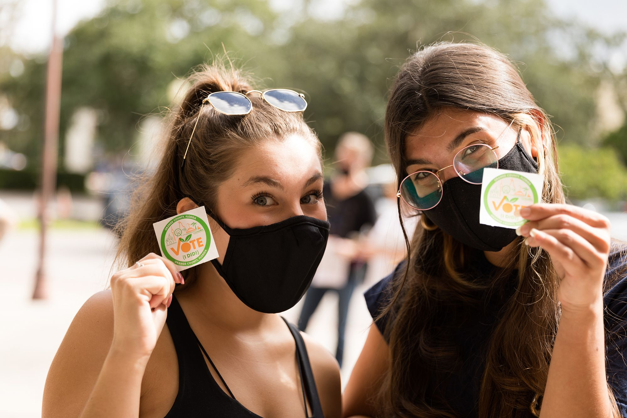 """Rollins students showing off their """"I voted"""" stickers after casting early votes in the 2020 presidential election."""