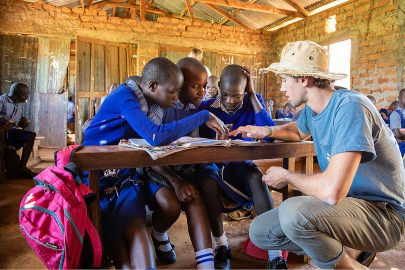 A Rollins student tutoring children in Rwanda.