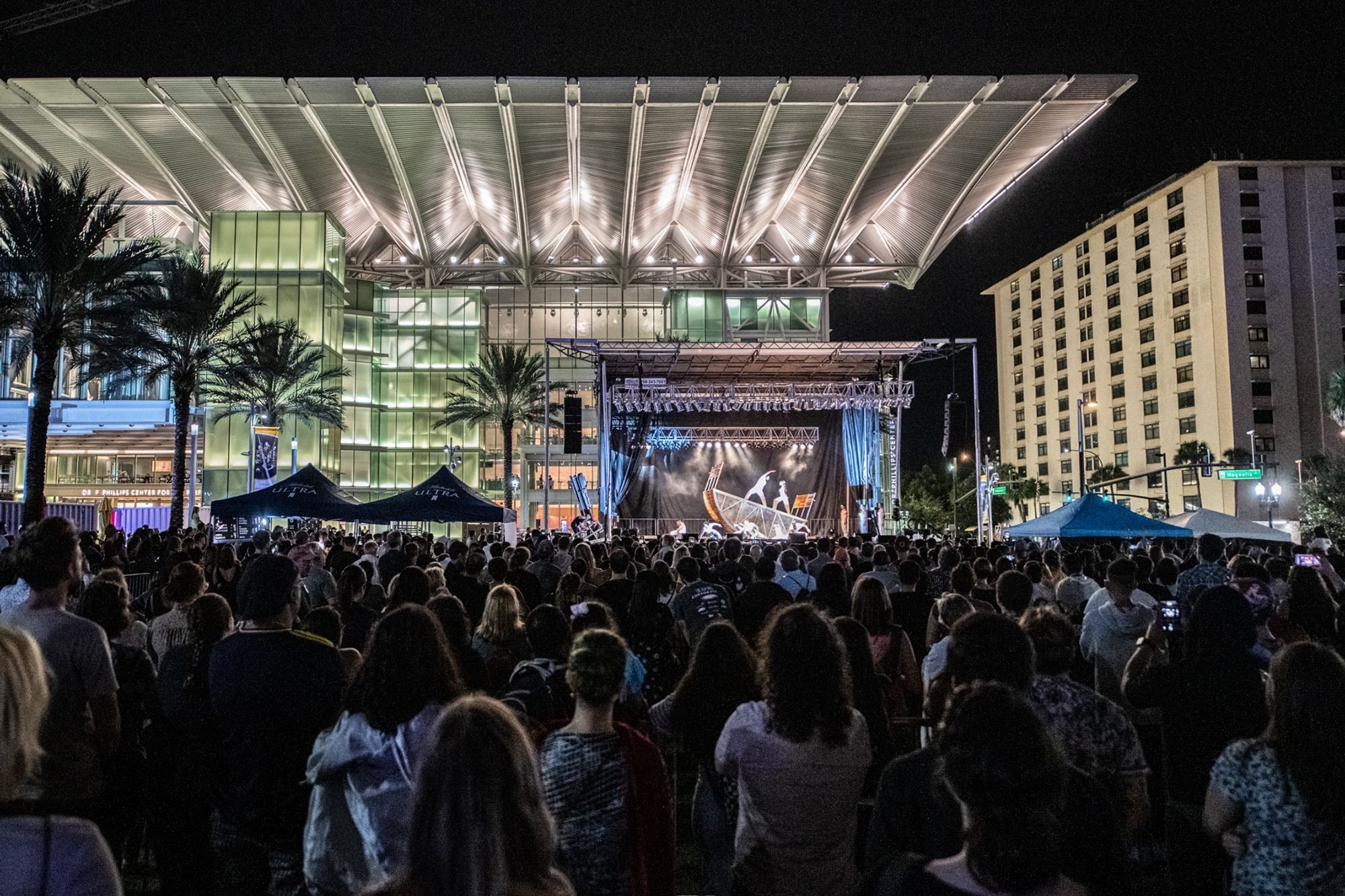 A large crowd watches a performance at the Dr. Phillips Center in downtown Orlando.