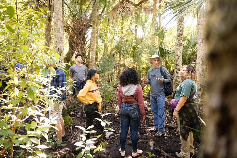 Environmental studies professor Barry Allen leads students on a field study at Canaveral National Seashore.